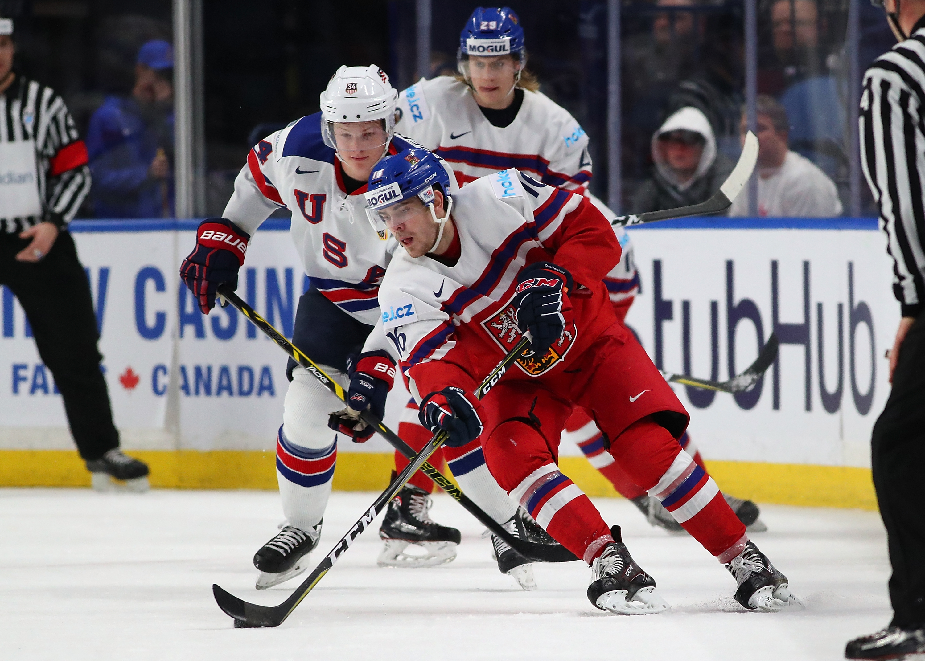 BUFFALO, NY - JANUARY 5: Martin Kaut #16 of Czech Republic with the puck as Trent Frederic #34 of United States defends in the first period during the Bronze Medal Game of the IIHF World Junior Championship at KeyBank Center on January 5, 2018 in Buffalo,