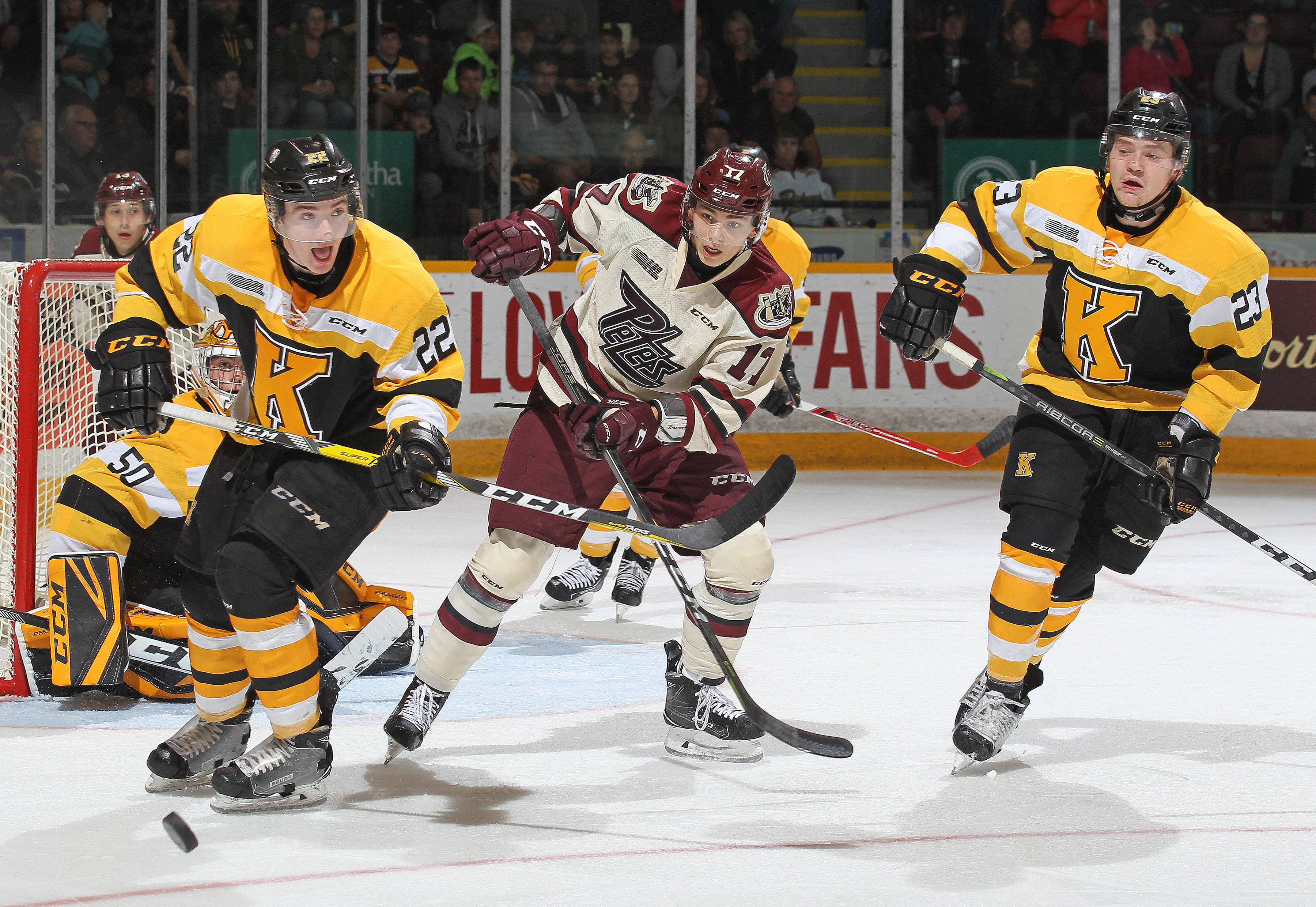 PETERBOROUGH, ON - OCTOBER 12: Jakob Brahaney #22 of the Kingston Frontenacs skates after a puck against Pavel Gogolev #17 of the Peterborough Petes in an OHL game at the Peterborough Memorial Centre on October 12, 2017 in Peterborough, Ontario.