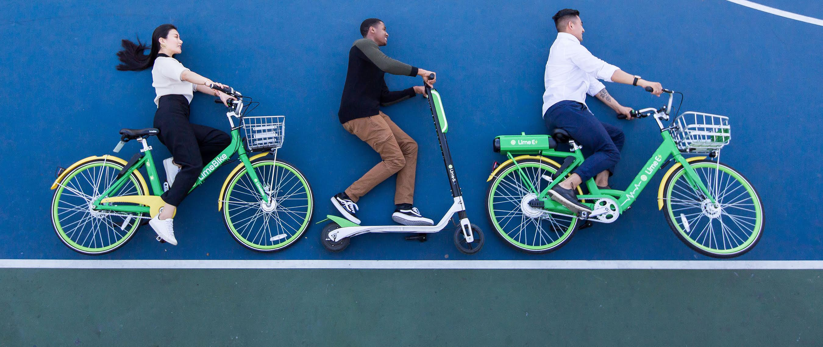 A picture of people on Lime's scooters and bikes