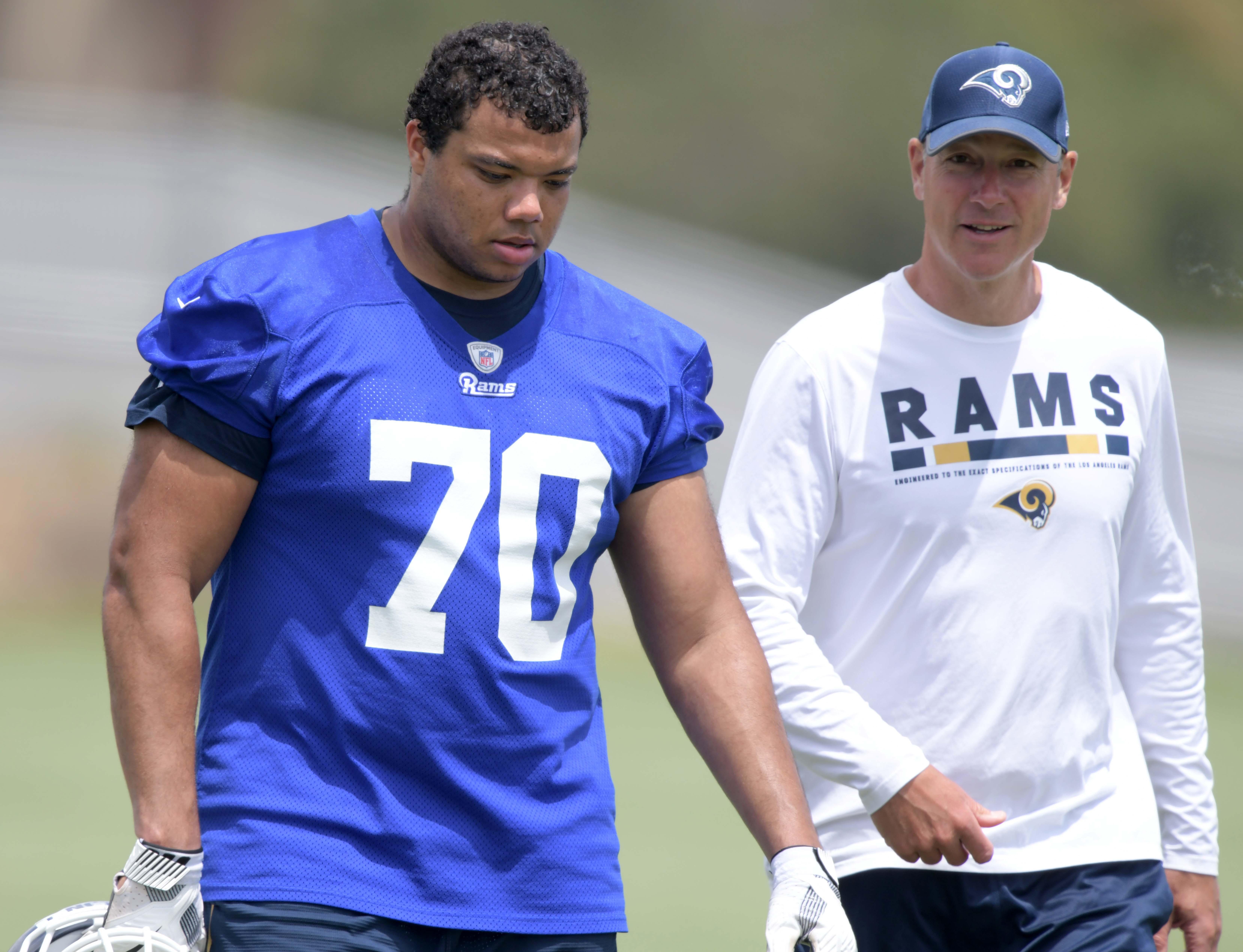 Los Angeles Rams rookie OT Joseph Noteboom walks with Run Game Coordinator and Offensive Line Coach Aaron Kromer during organized team activities, June 4, 2018.