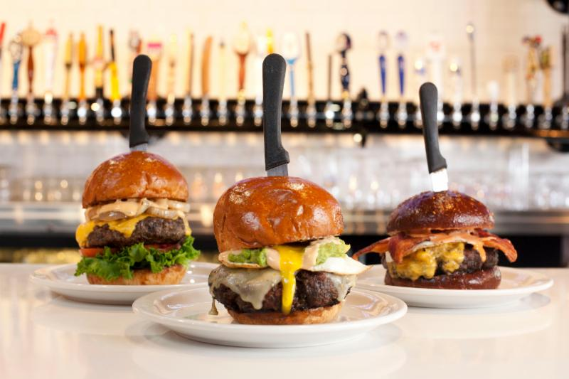 From left: Slater's 50/50's Best Damn Bacon Cheeseburger, the Original 50/50 Burger, and the BBB Bacon