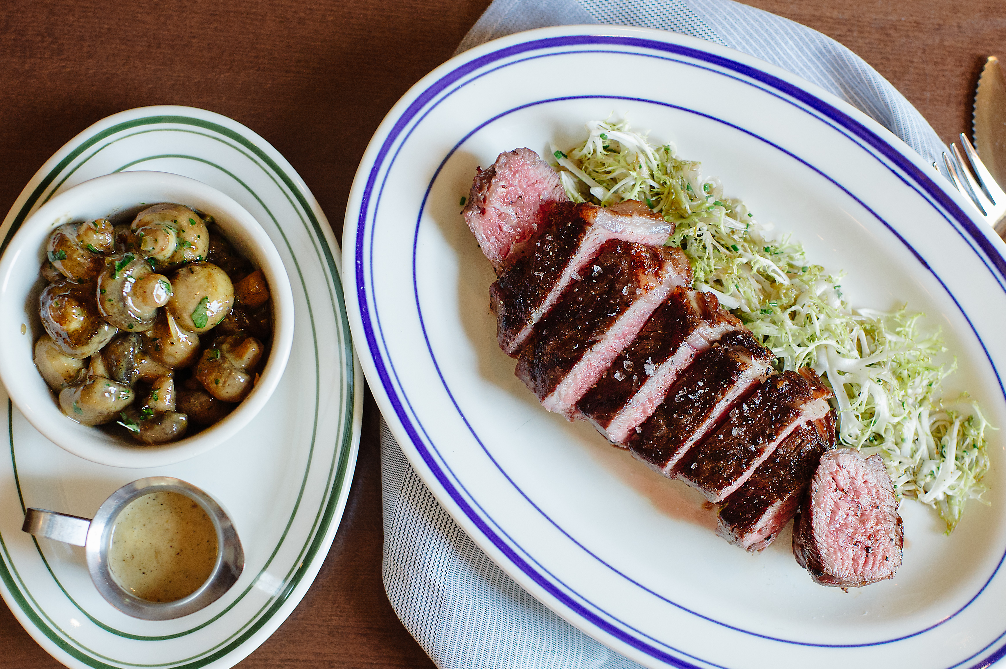 NY strip steak with Madeira and veal jus glazed button mushrooms