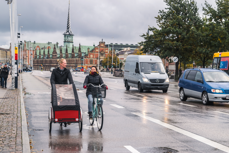 people riding cargo bike and bike