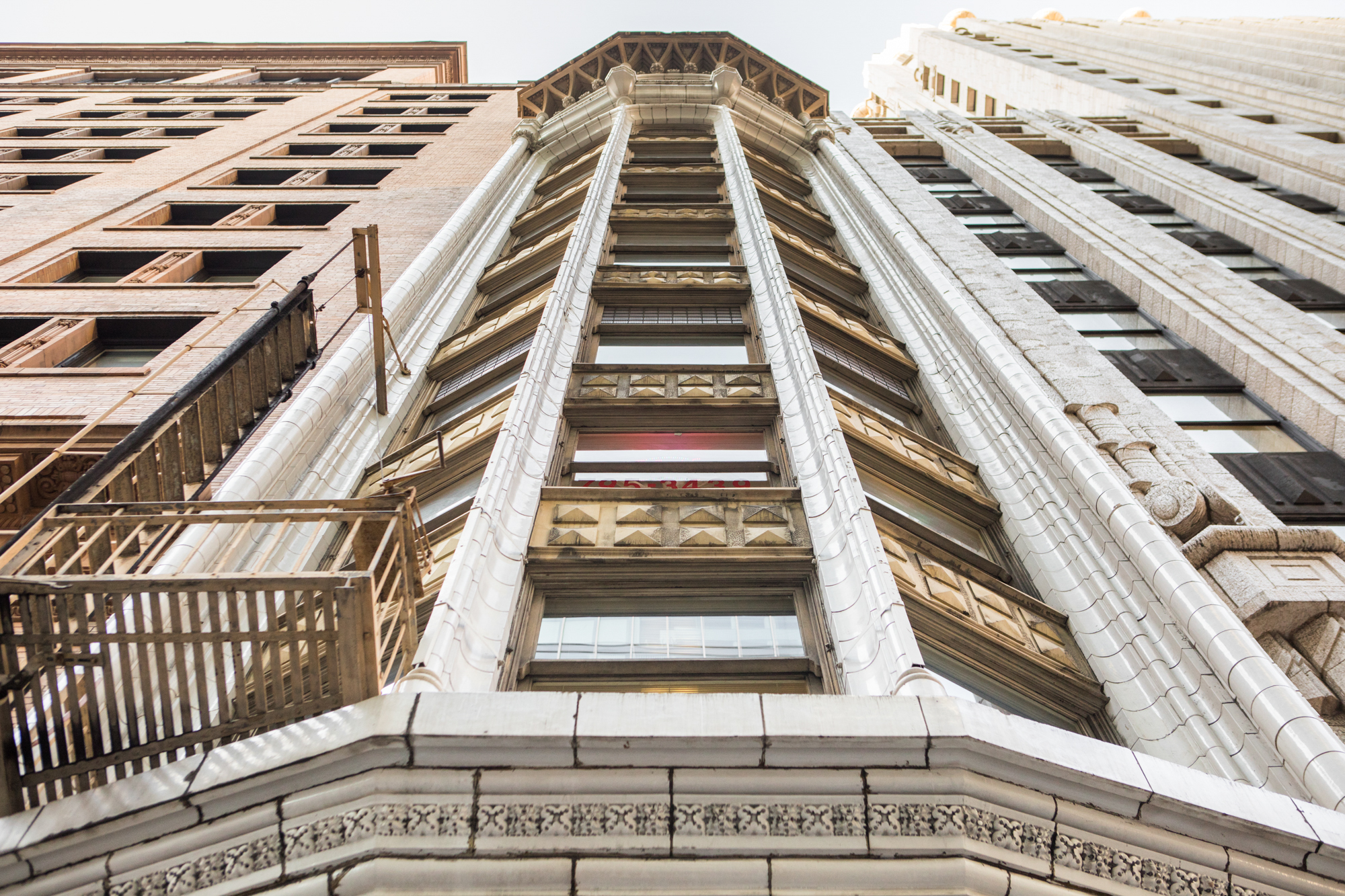 The exterior of the Heineman Building in San Francisco. The facade is white with ornate gold design.