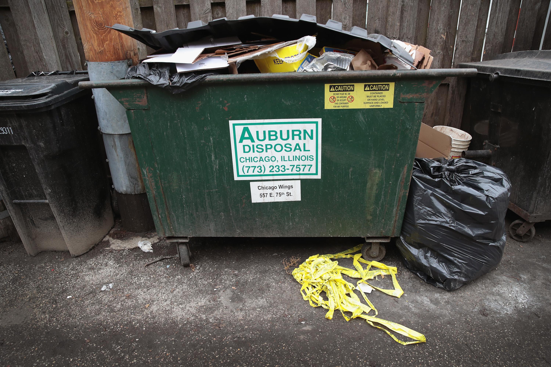 Dumpster full of trash - metaphor