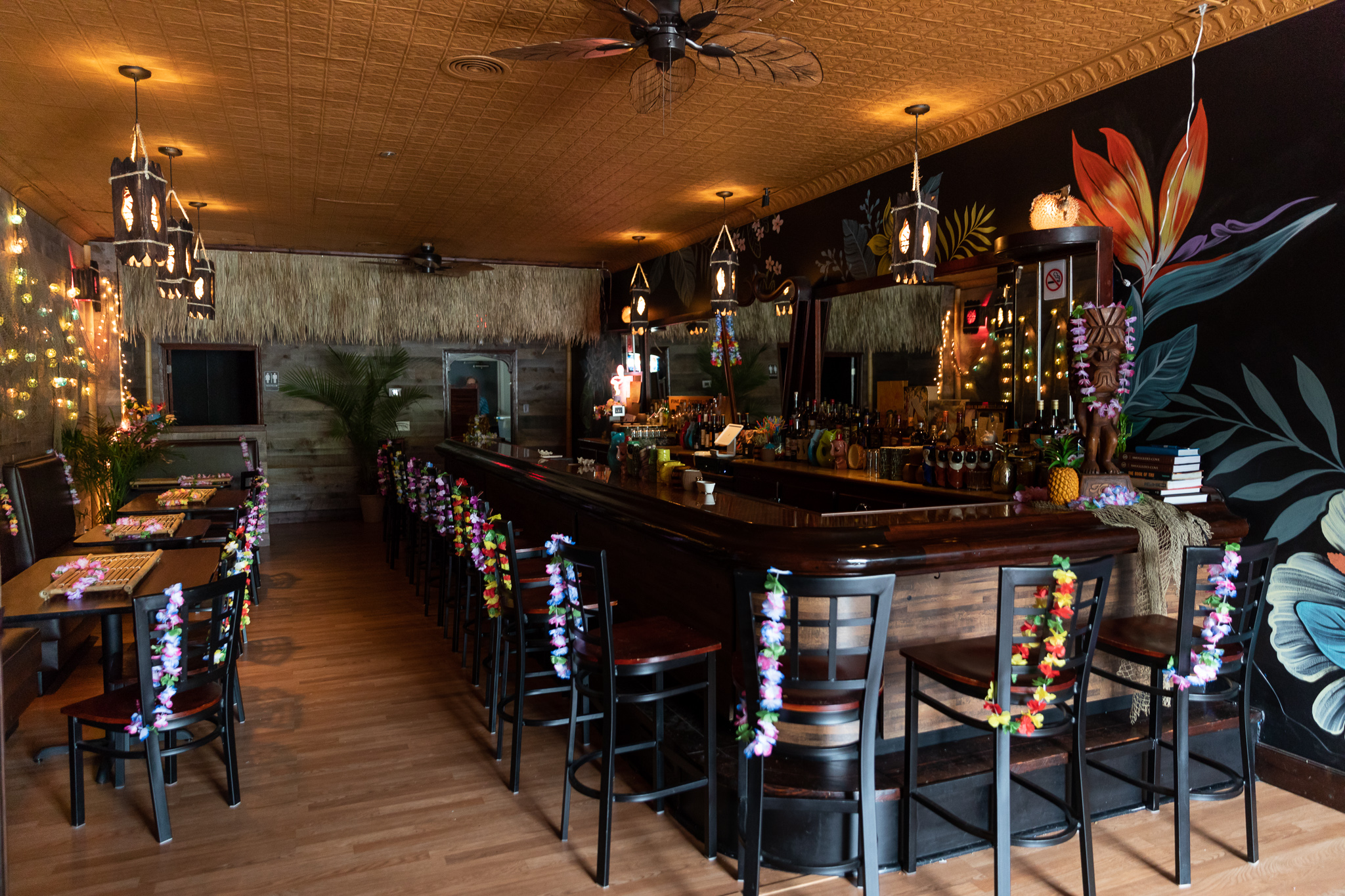 Lost River Tiki Bar's interior including the bar and a mural of flowers