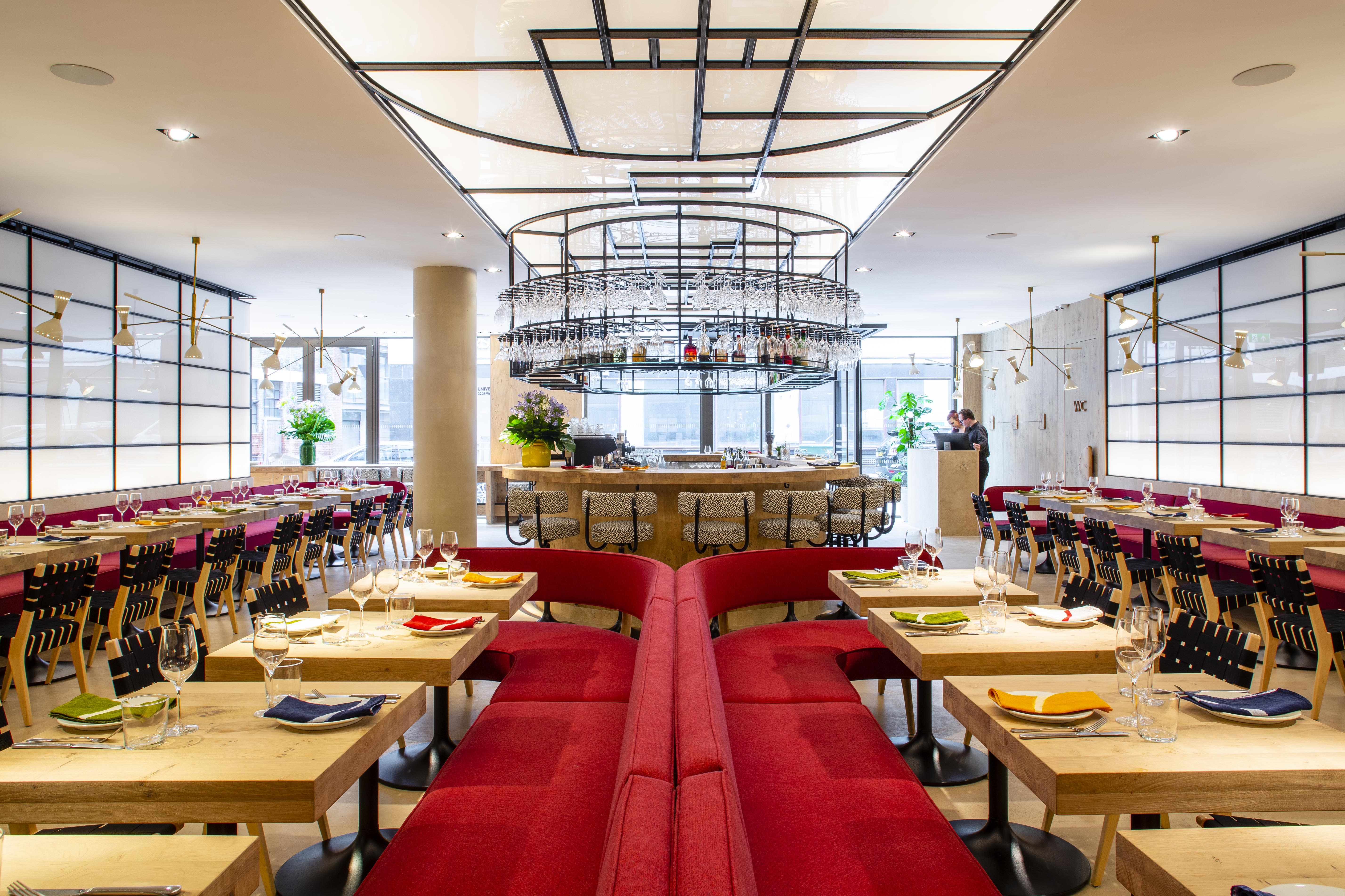The sleek, symmetrical red interior at Ottolenghi's new restaurant, Rovi