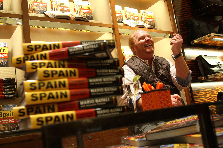 Mario Batali signing cookbooks