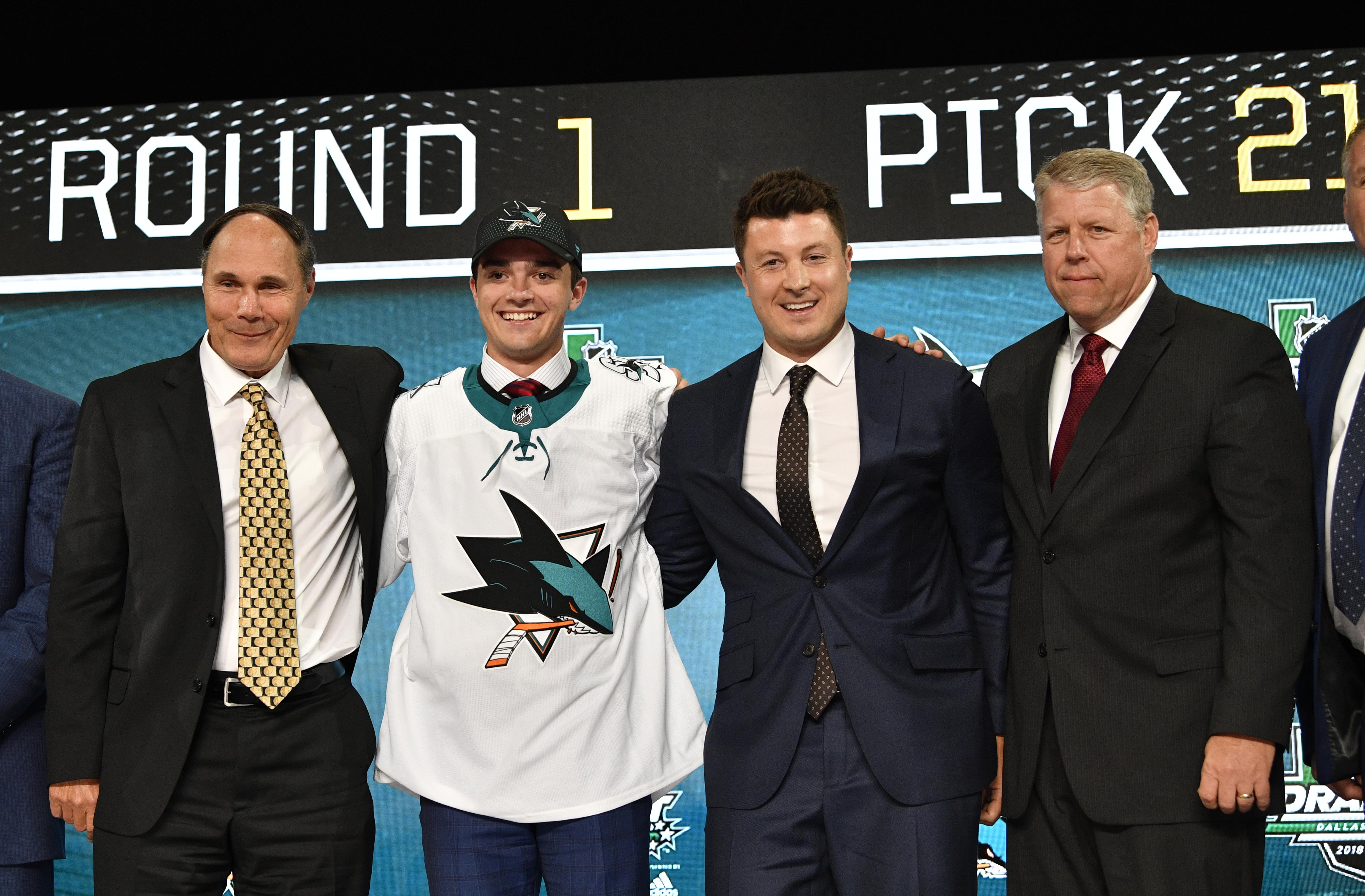 Jun 22, 2018; Dallas, TX, USA; Ryan Merkley poses for a photo with team representatives after being selected as the number twenty-one overall pick to the San Jose Sharks in the first round of the 2018 NHL Draft at American Airlines Center.