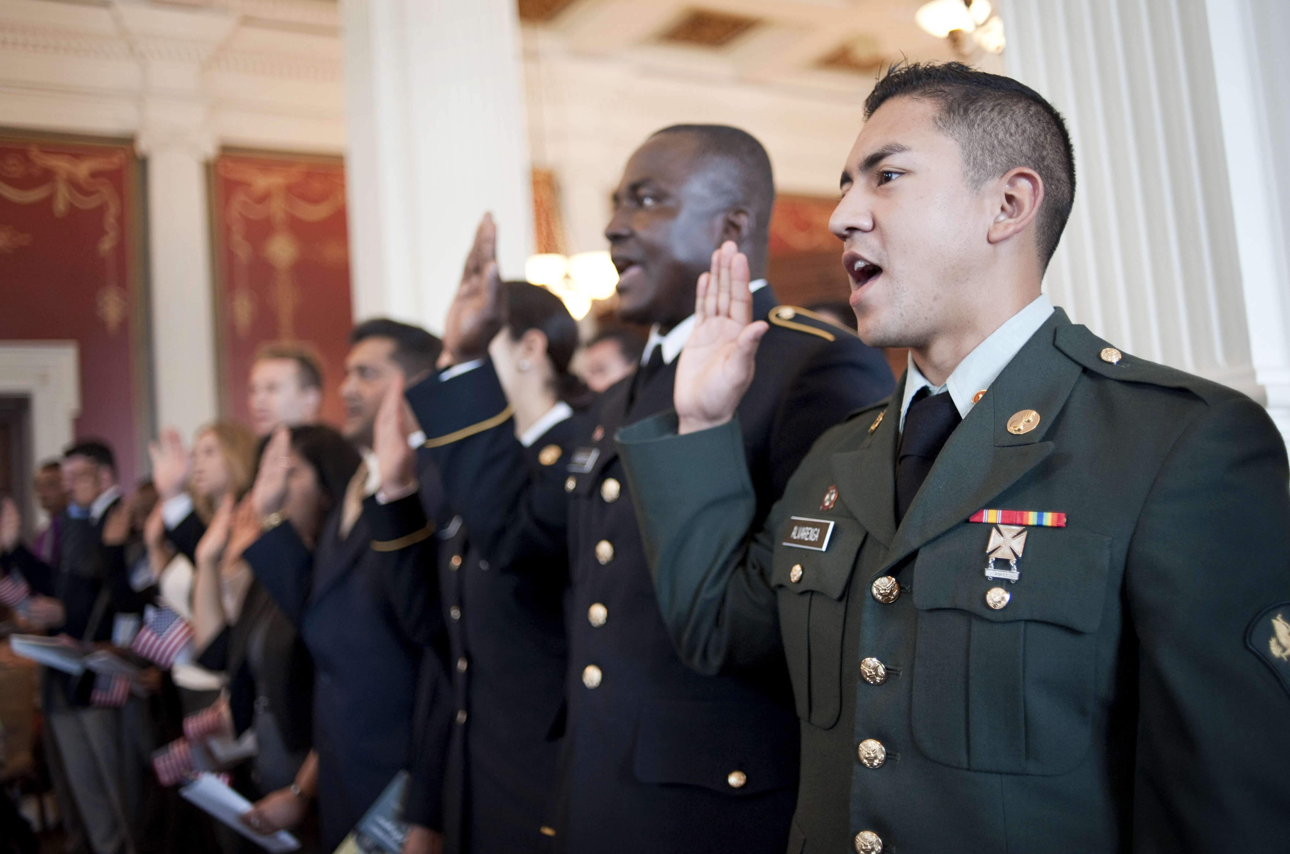 A naturalization service — prominently featuring soldiers — at the Library of Congress, 2013.