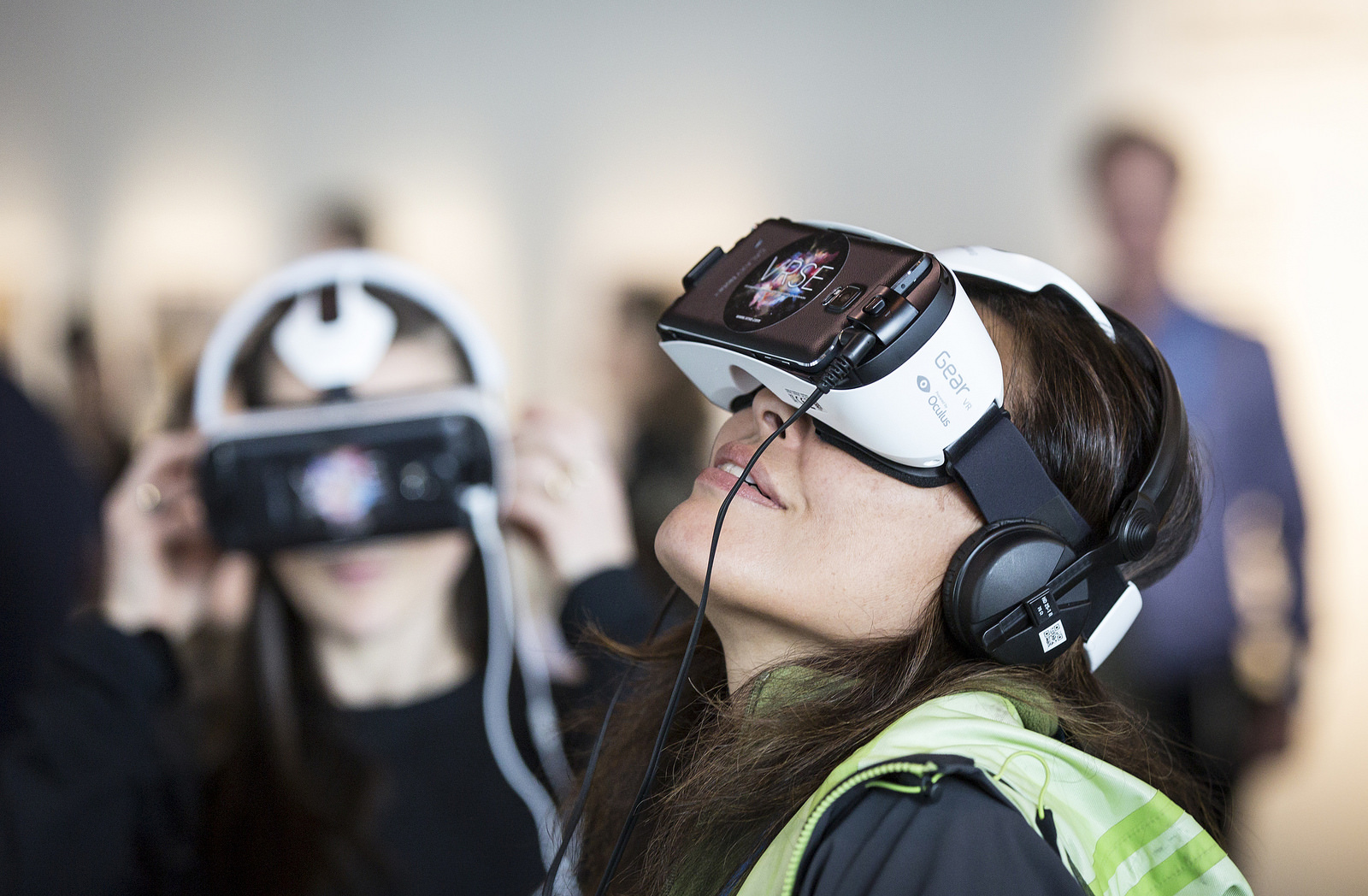 Two people wearing virtual reality headsets