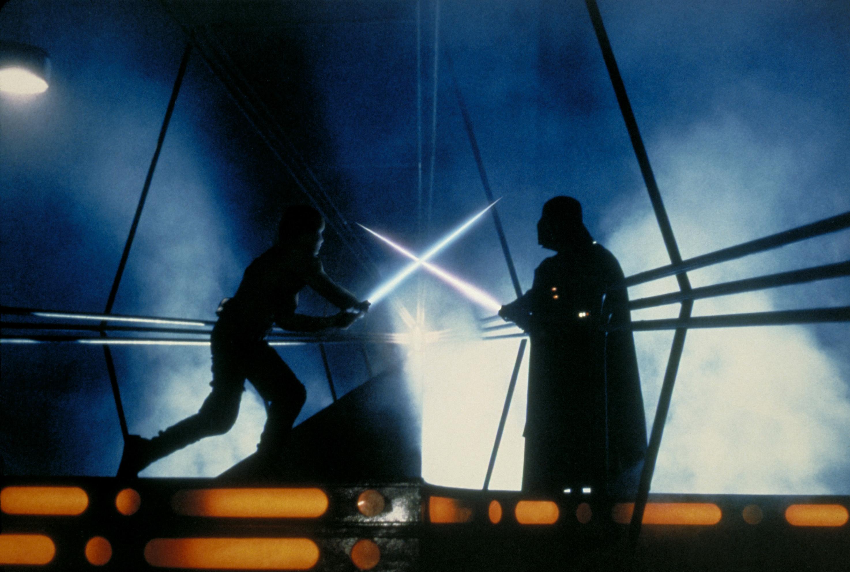 Luke Skywalker fighting a lightsaber battle against Darth Vader