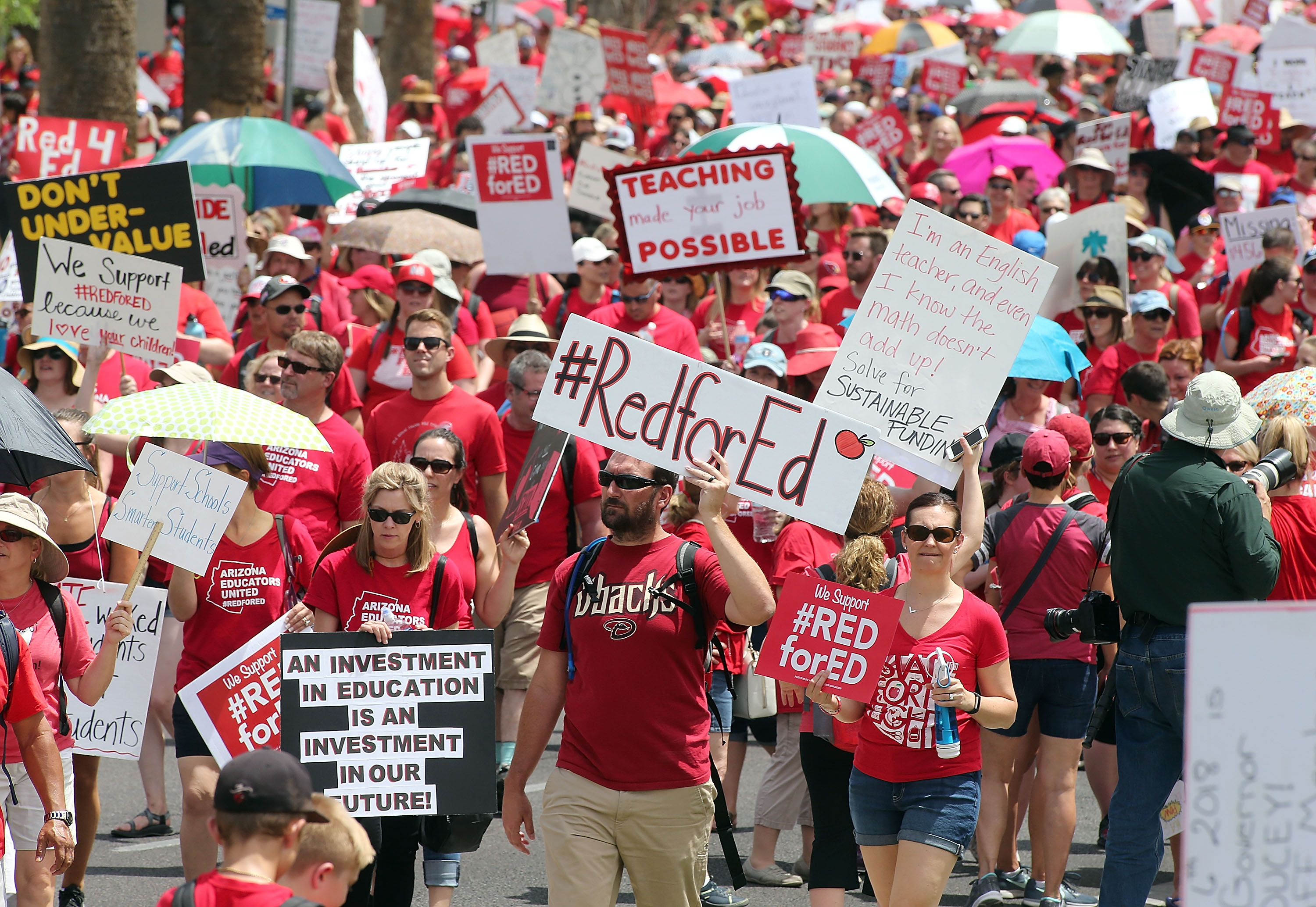 Striking Arizona teachers march toward the State Capitol, in Phoenix, as part of a rally for the #REDforED movement, in April.
