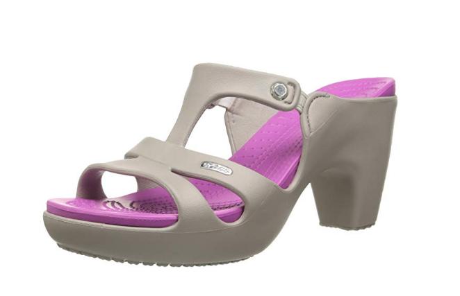 A pair of gray and light purple Croc heels.