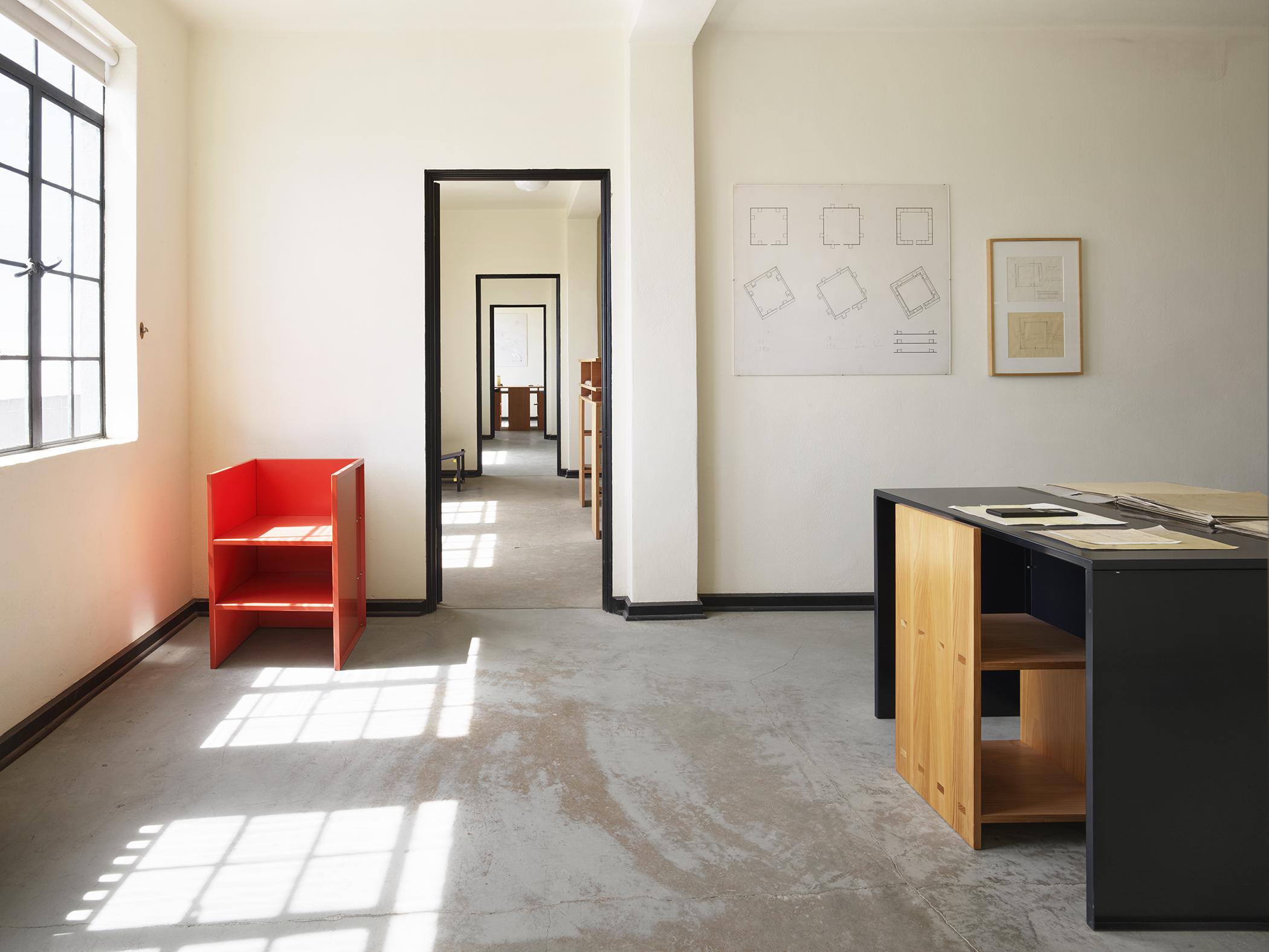 Wooden desks on concrete floor