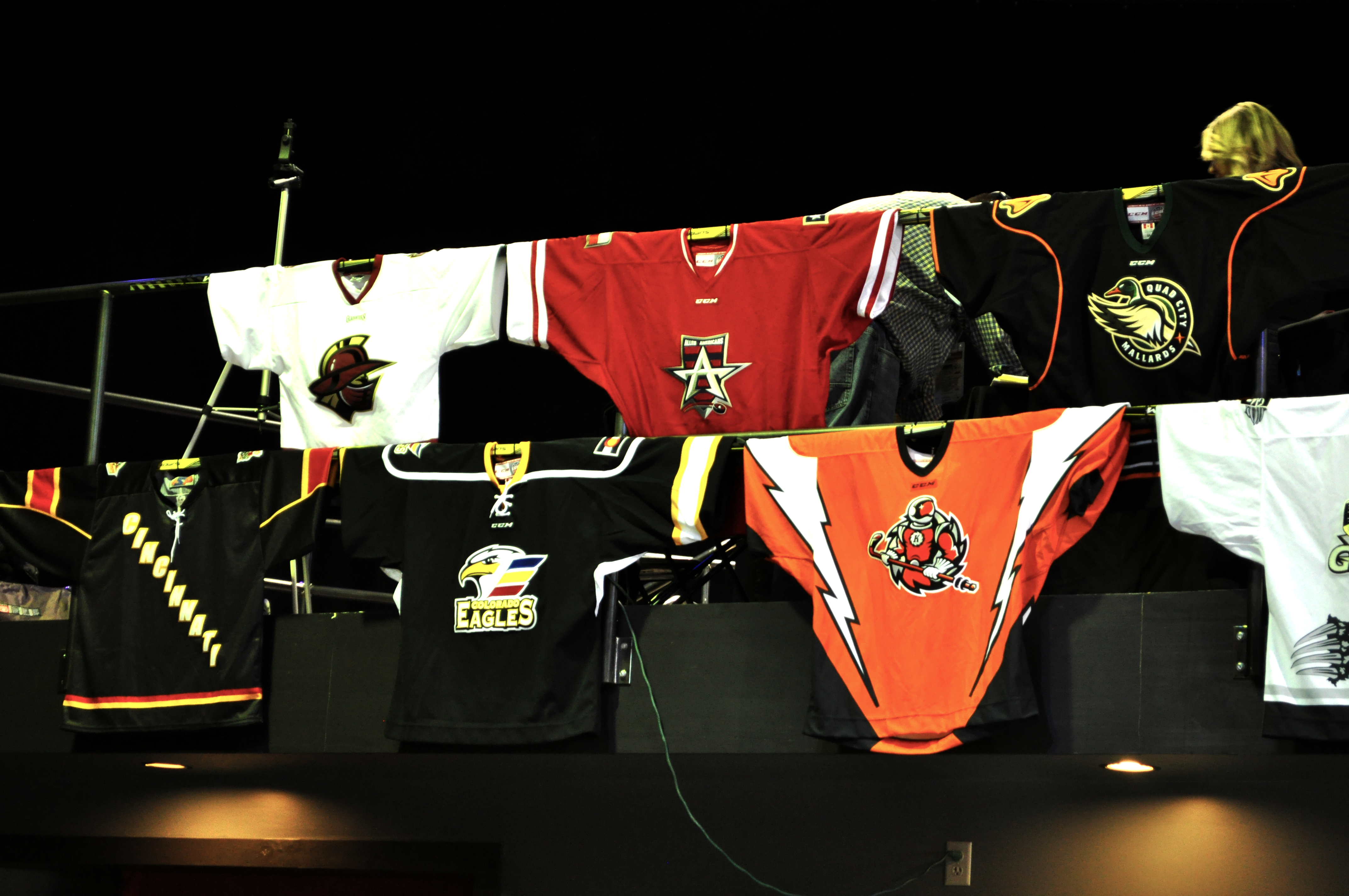 ECHL Mountain Division jerseys hanging on display at the 2018 ECHL All-Star Game Fan Fest in Indianapolis, Indiana.