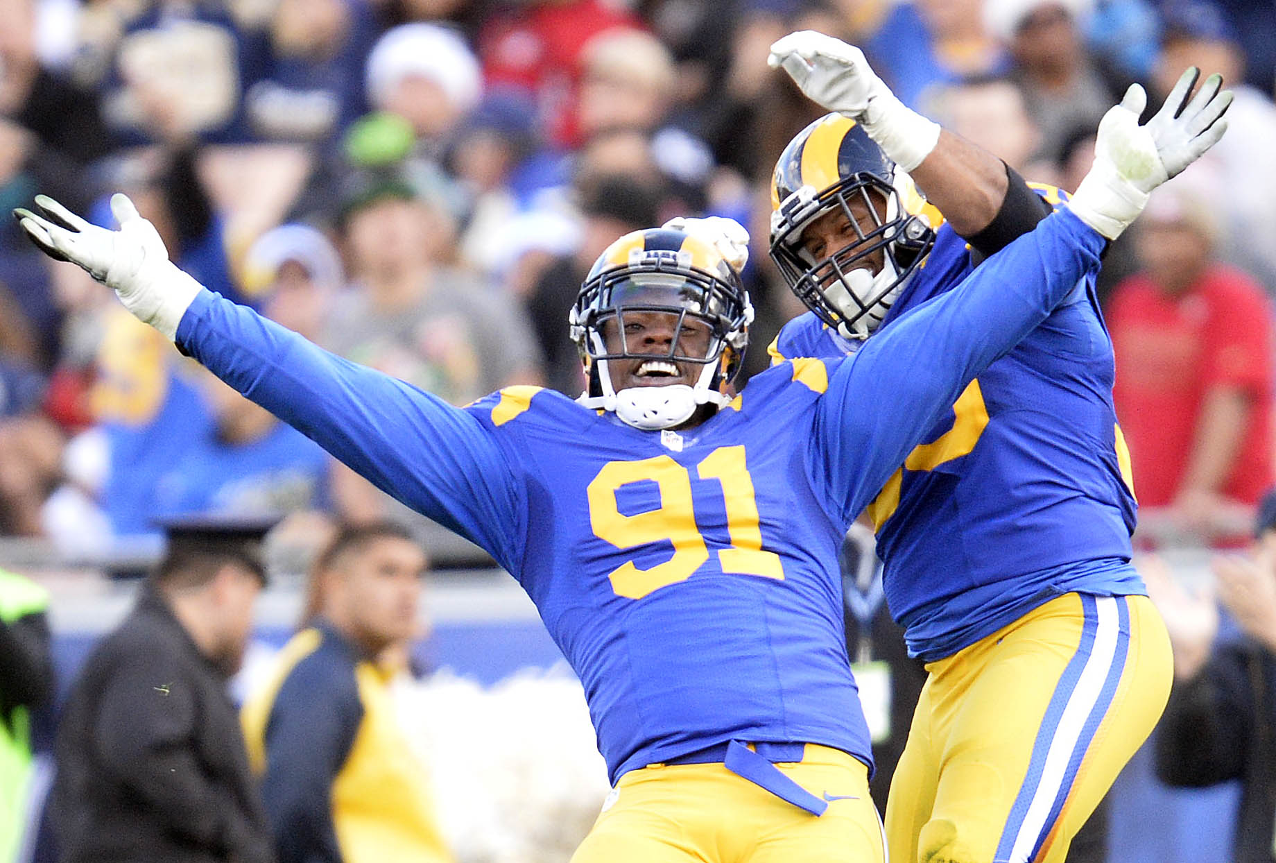 Los Angeles Rams DE Dominique Easley celebrates with DL Aaron Donald after sacking San Francisco 49ers QB Colin Kaepernick in Week 16, December 24, 2016.