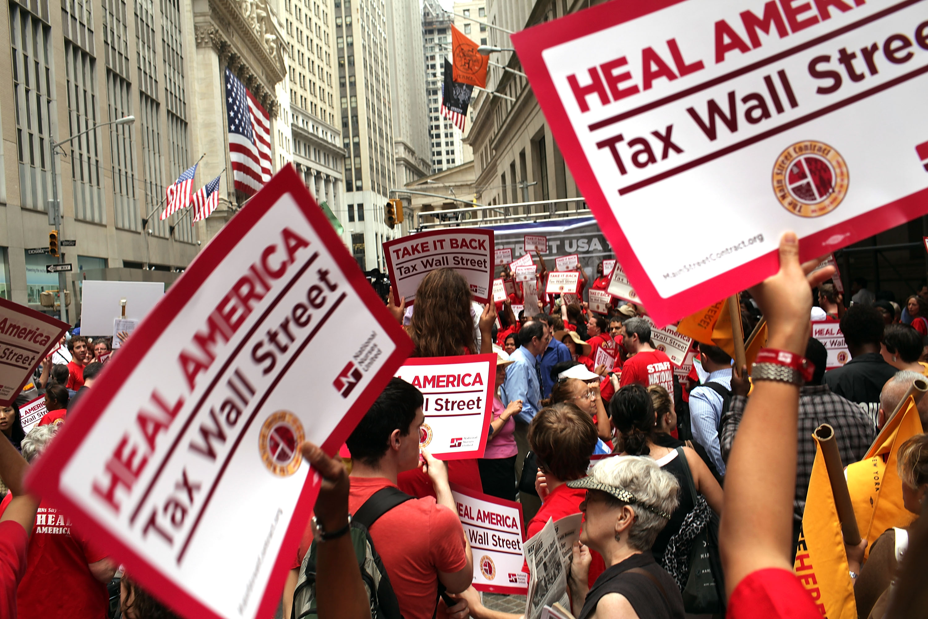 Members of the nurses union, National Nurses United, and other workers converge on Wall Street to protest against financial intuitions and inequality on June 22, 2011 in New York City.