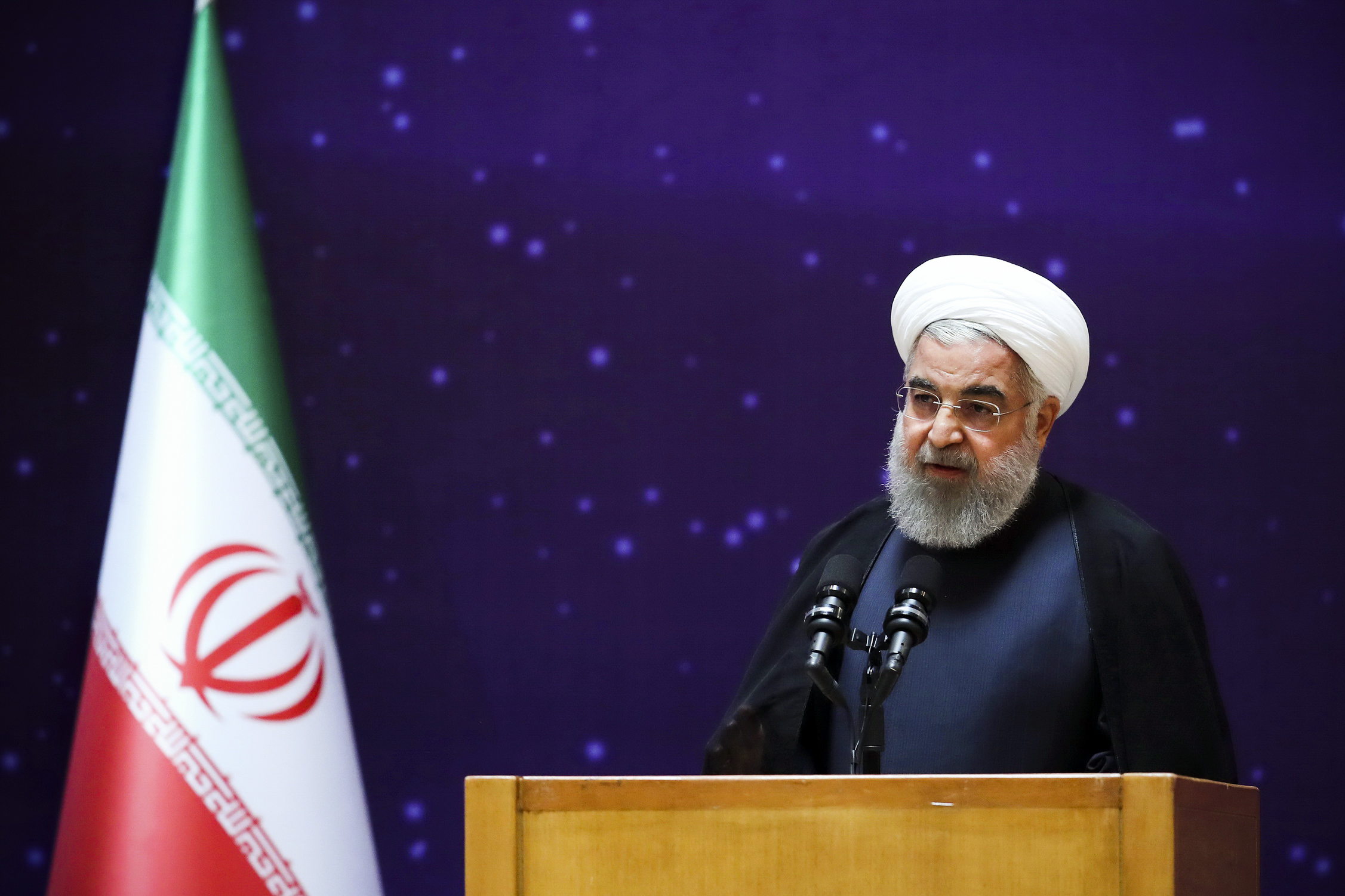"""President Hassan Rouhani speaks in a ceremony to mark """"National Nuclear Day,"""" dedicated to the country's achievements in nuclear technology, in Tehran, Iran, on April 9, 2018."""