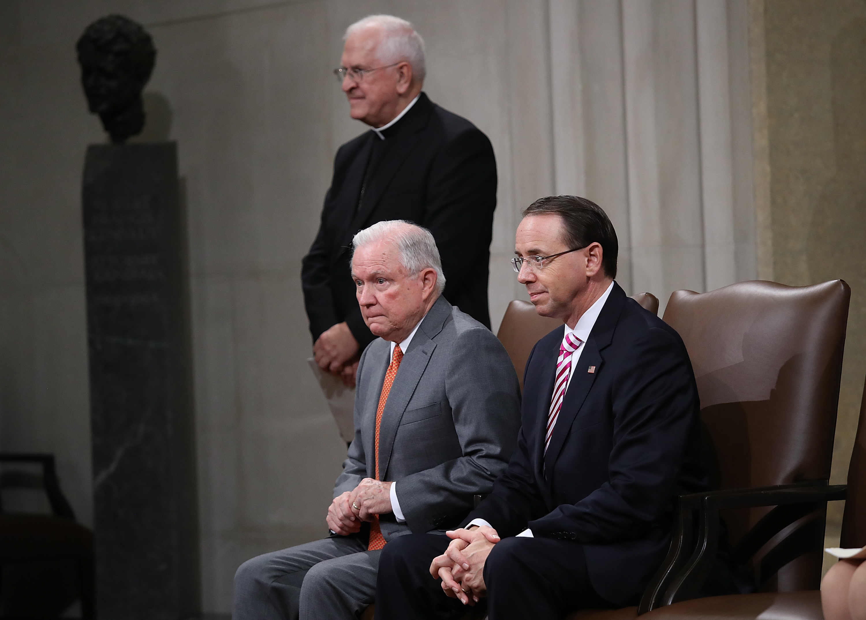 US Attorney General Jeff Sessions (C) and Deputy Attorney General Rod Rosenstein (R) attend the Religious Liberty Summit at the Department of Justice, on July 30. Also pictured is Archbishop Joseph Kurtz (L), chairman of the Committee for Religious Libert