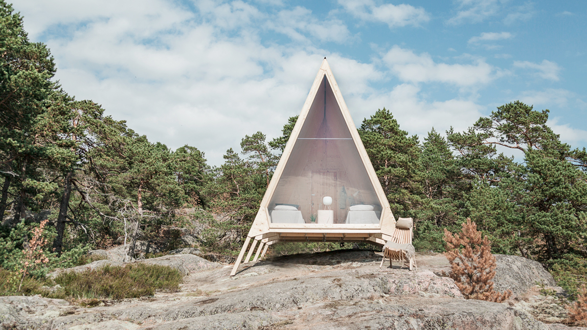 This eco-friendly cabin is in the shape of a triangle, with an interior about the size of a small bedroom and rising about 13 feet tall. The exterior is clad in solar panels to help it reach minimal emissions, while the rest of the cabin is built from ply