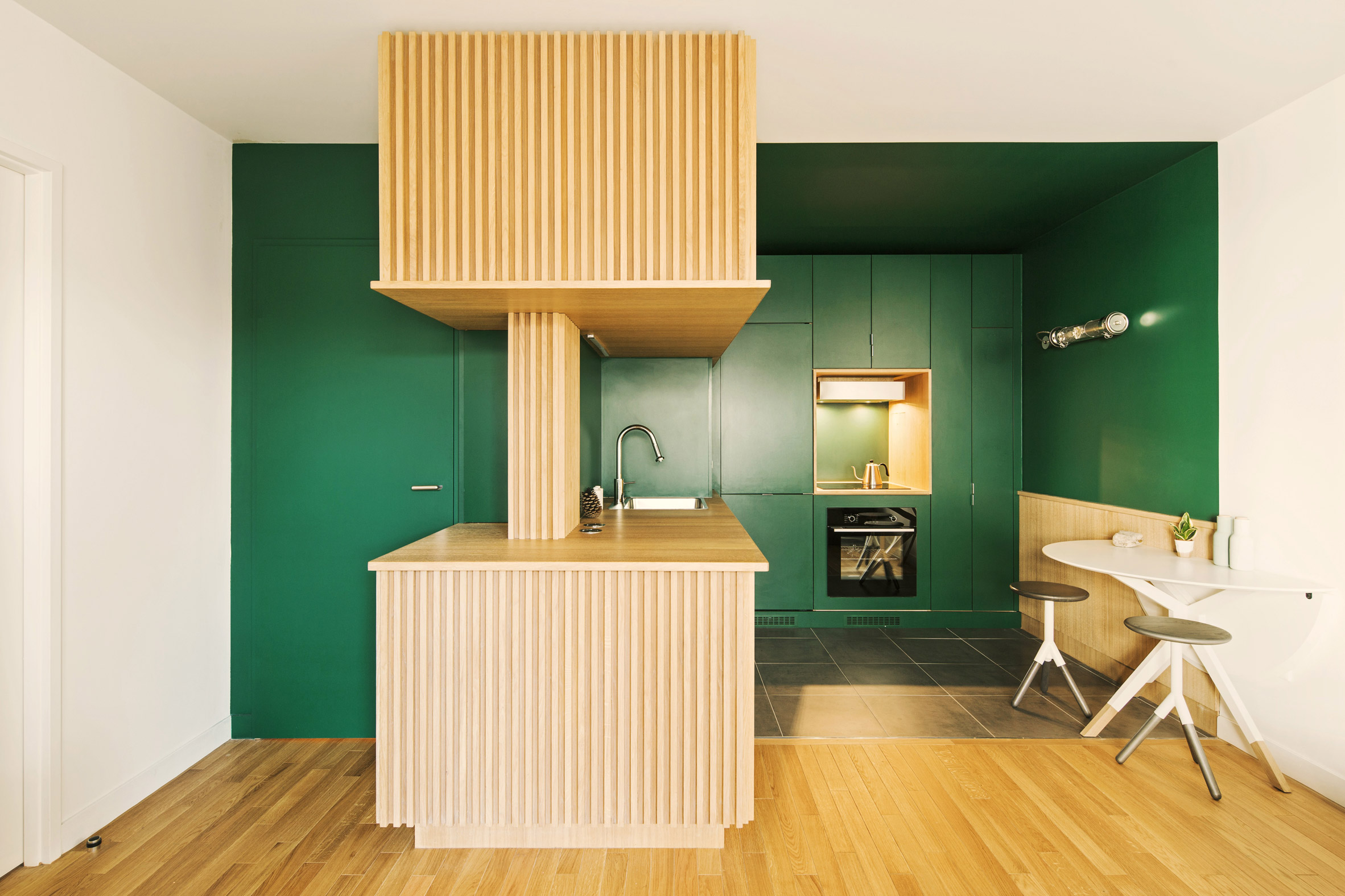 Apartment with green-walled kitchen