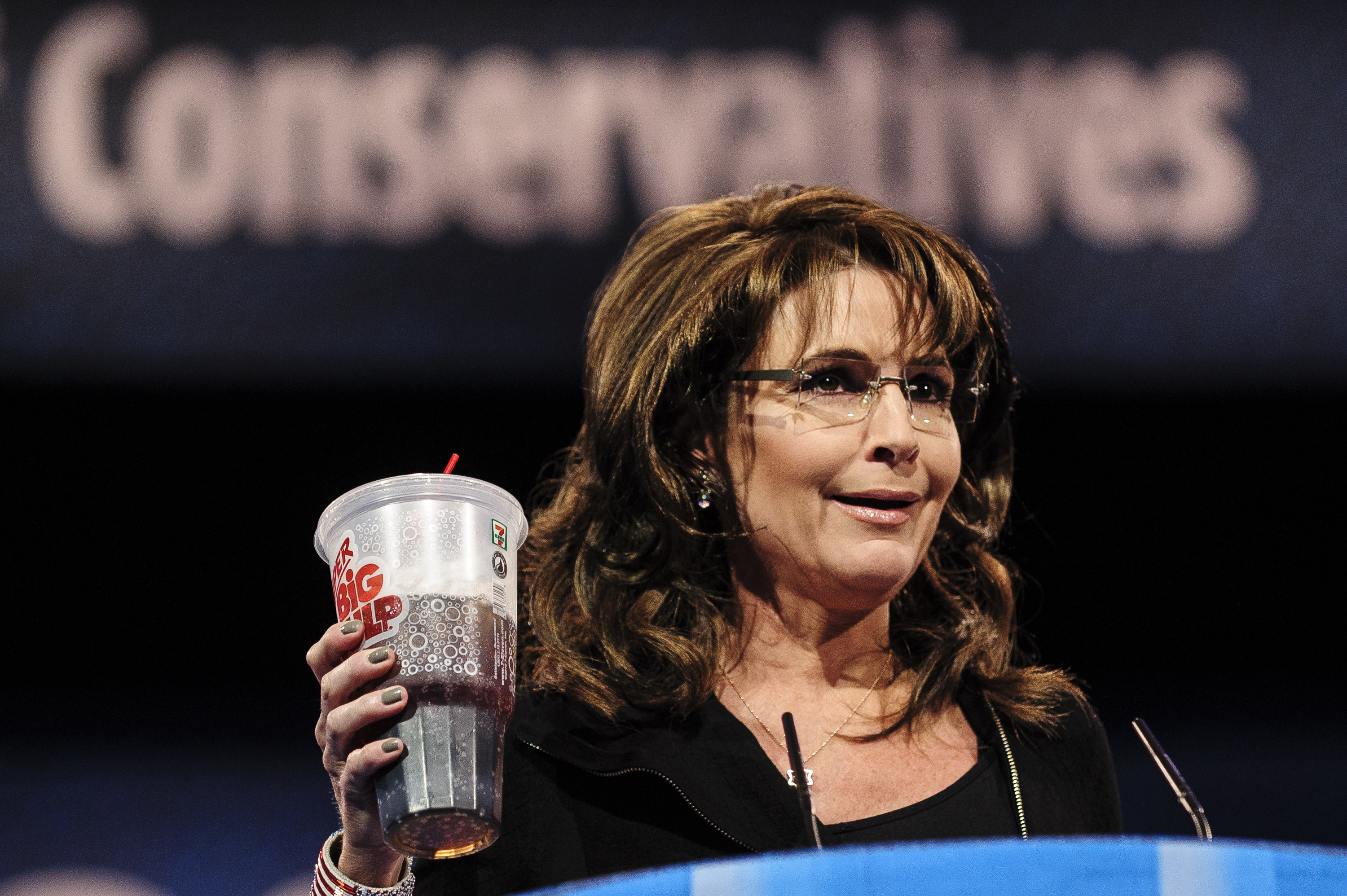 Former Republican vice presidential candidateSarah Palin drinks a large soda on stage at the 2013 Conservative Political Action Conference.
