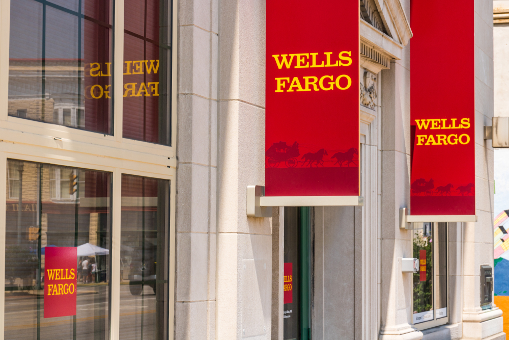 Wells Fargo banners outside of a bank.
