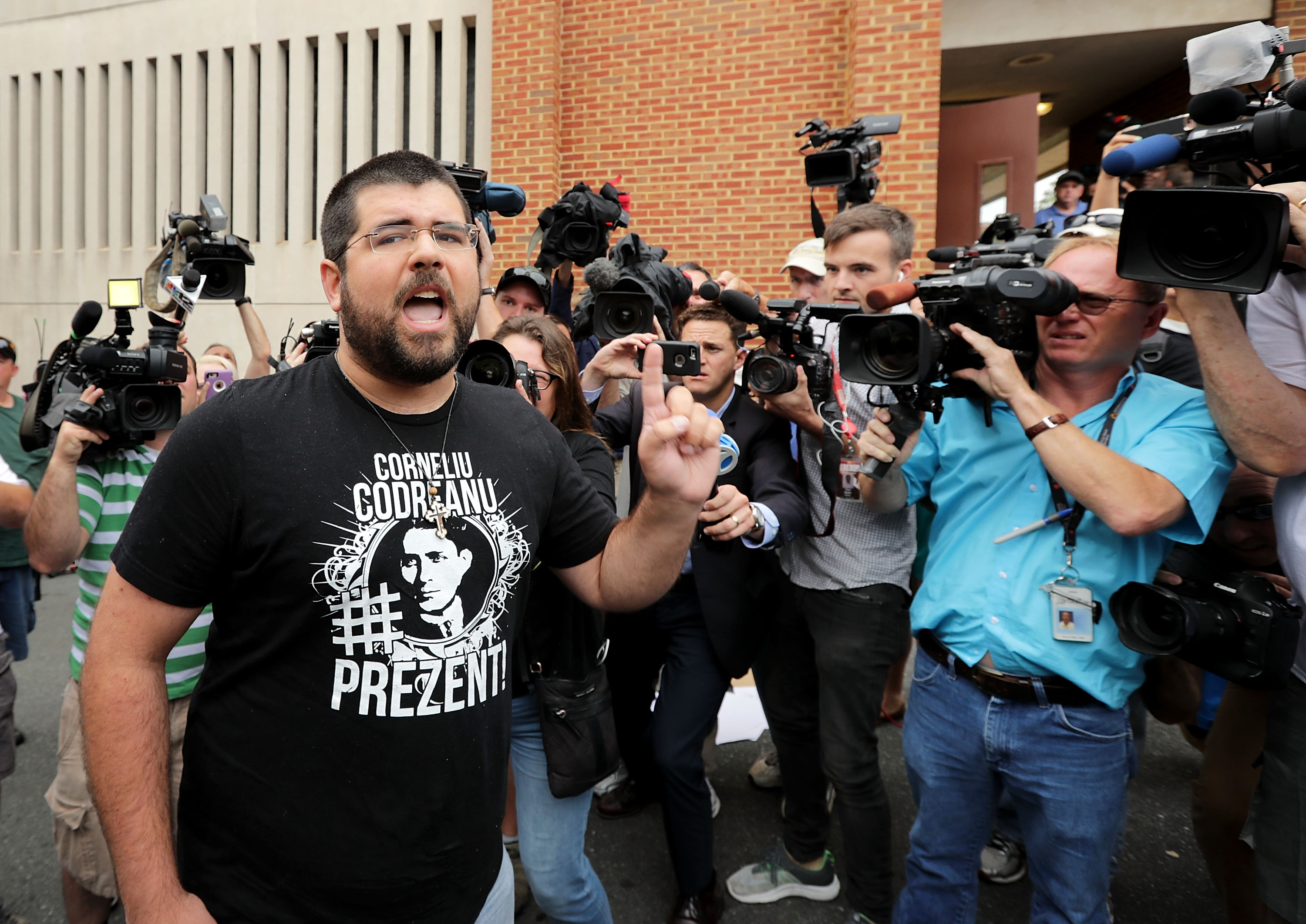 Matthew Heinbach, a white nationalist, shouts at reporters gathered outside the Charlottesville General District Court building August 14.