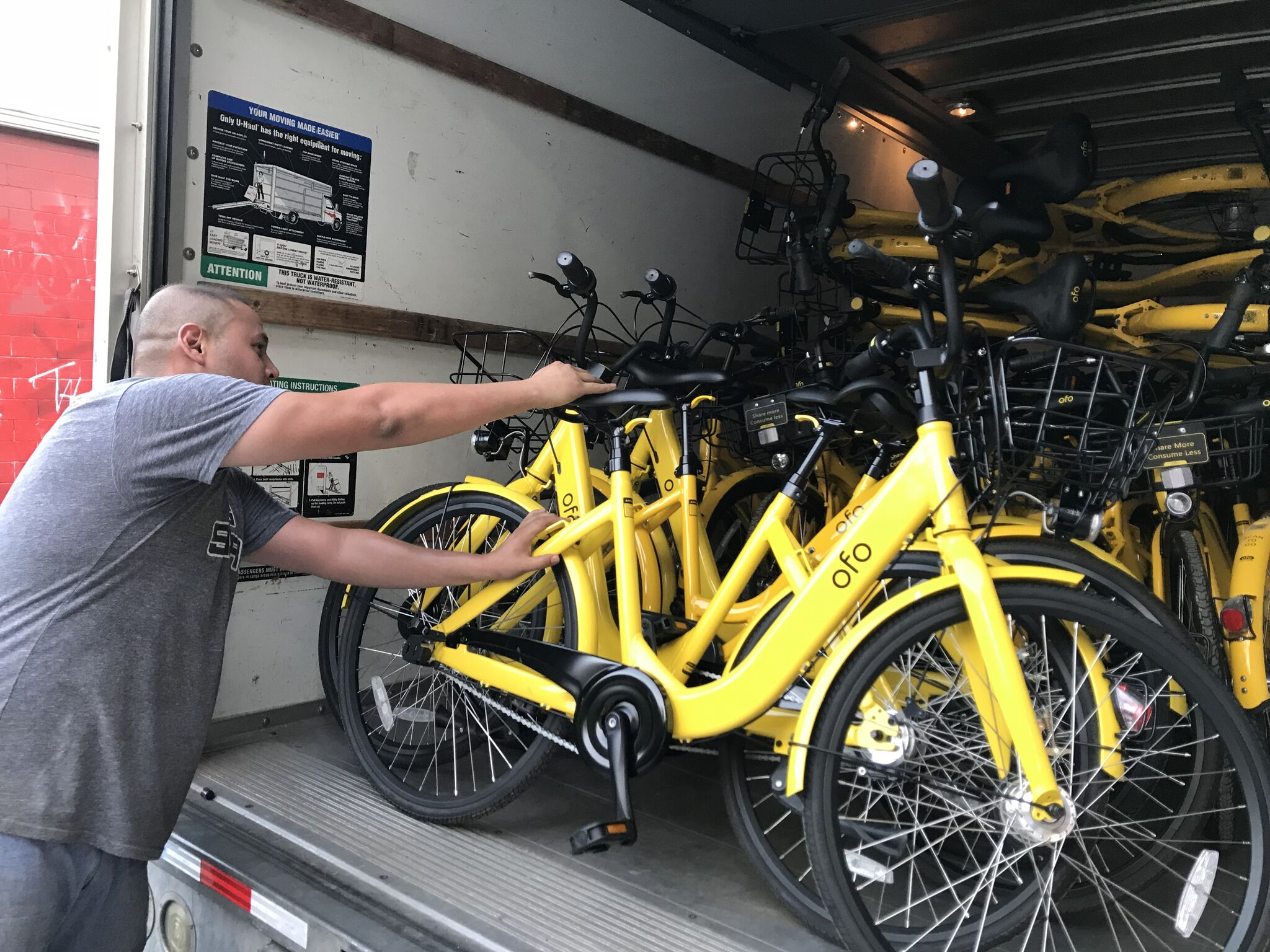 a photo of a man loading a bike into a truck