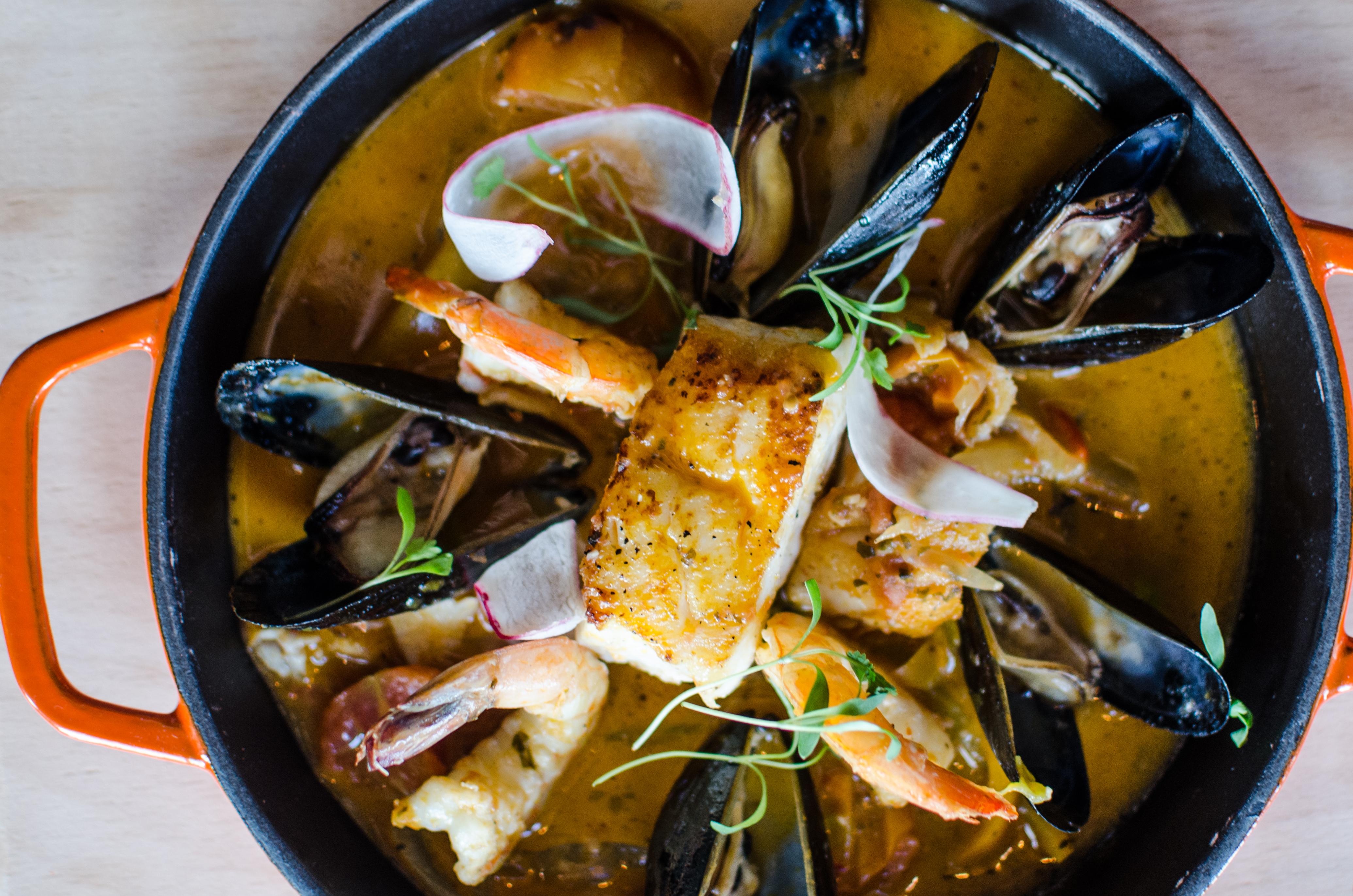 Casa Caña's enchilado de pescado: shrimp, mussel, and fish stew with tomatoes, cilantro, coconut, and citrus broth