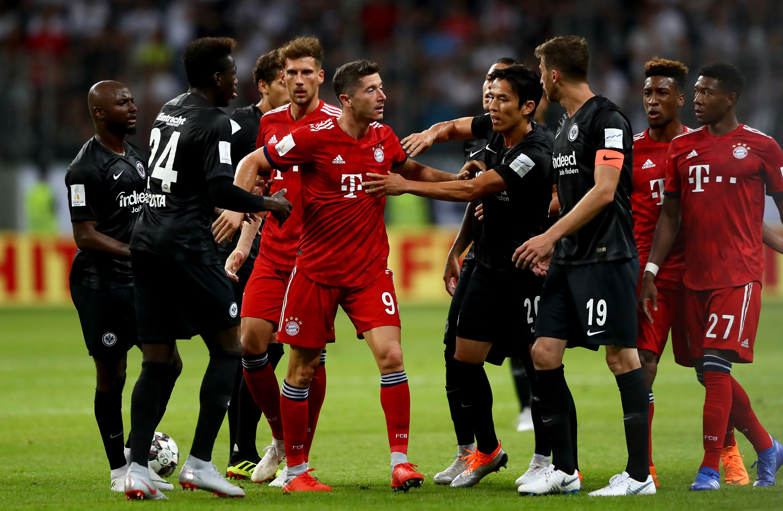 FRANKFURT AM MAIN, GERMANY - AUGUST 12: Robert Lewandowski (C) of Muenchen during the DFL Supercup 2018 between Eintracht Frankfurt and Bayern Muenchen at Commerzbank-Arena on August 12, 2018 in Frankfurt am Main, Germany.