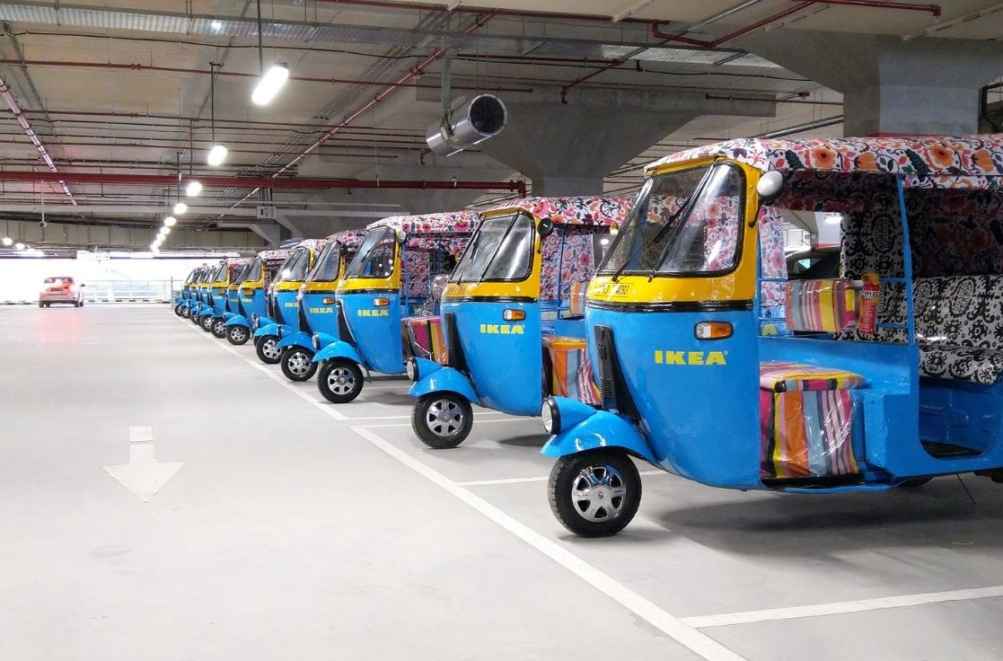 Blue and floral rickshaws in warehouse