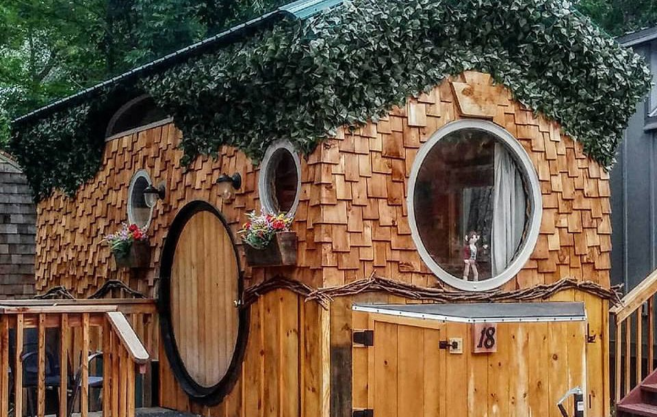 Wooden tiny house with circular windows