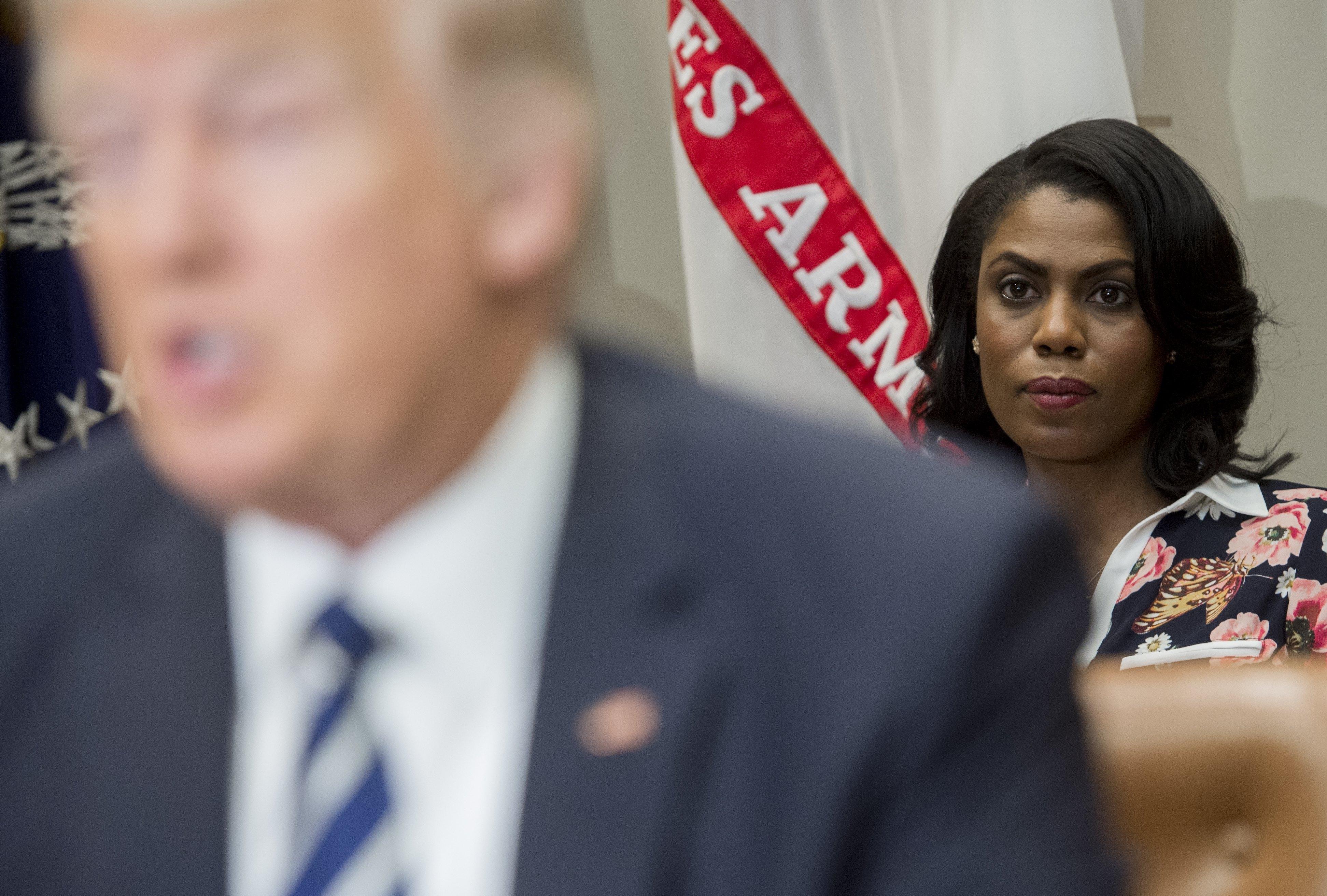 Omarosa Manigault Newman sits behind Donald Trump