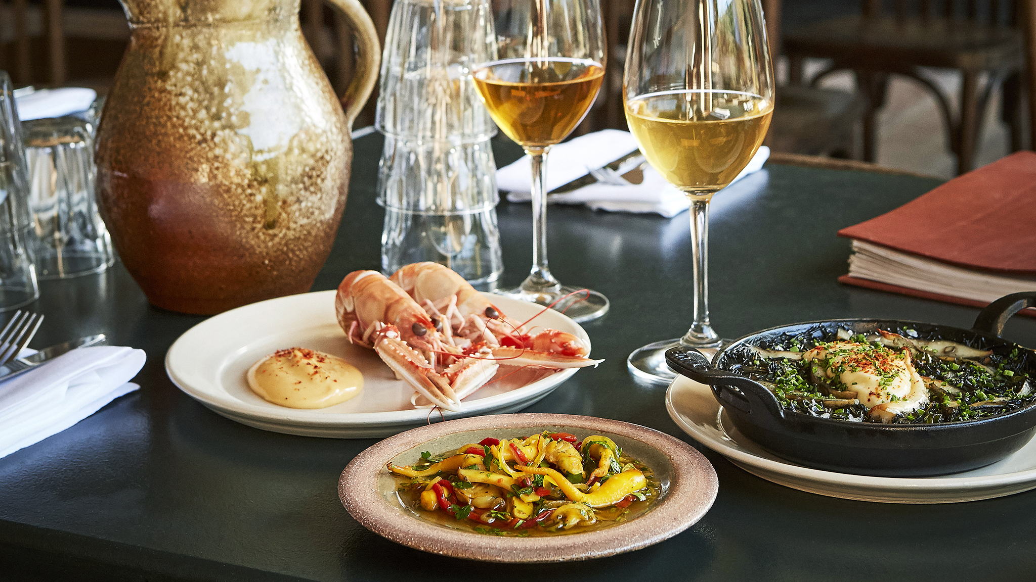 Best seafood restaurants in London: Prawns, cuttlefish, and natural wine at Westerns Laundry, one of the best restaurants in Islington