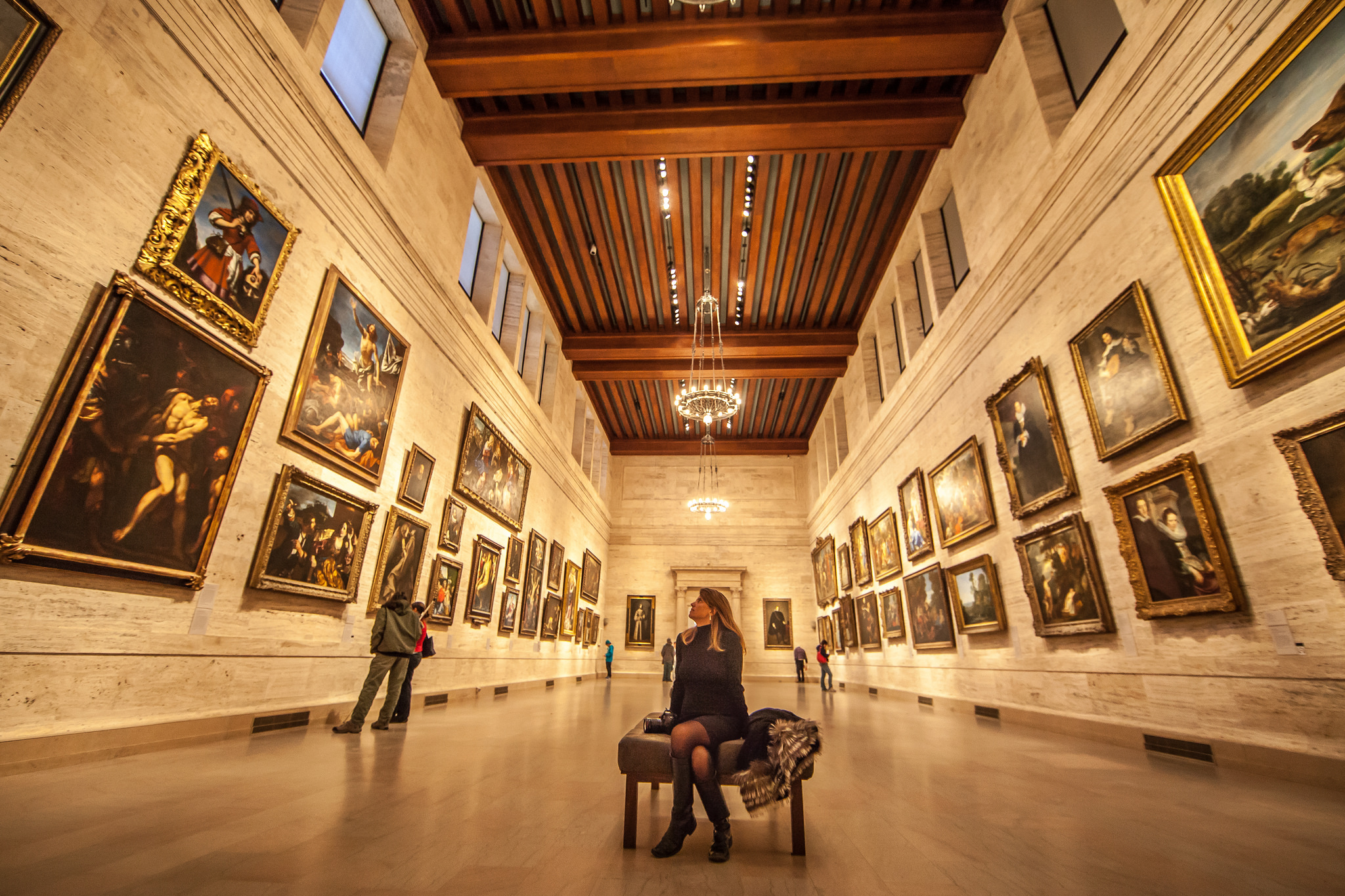 A woman sits in the Museum of Fine Arts, Boston
