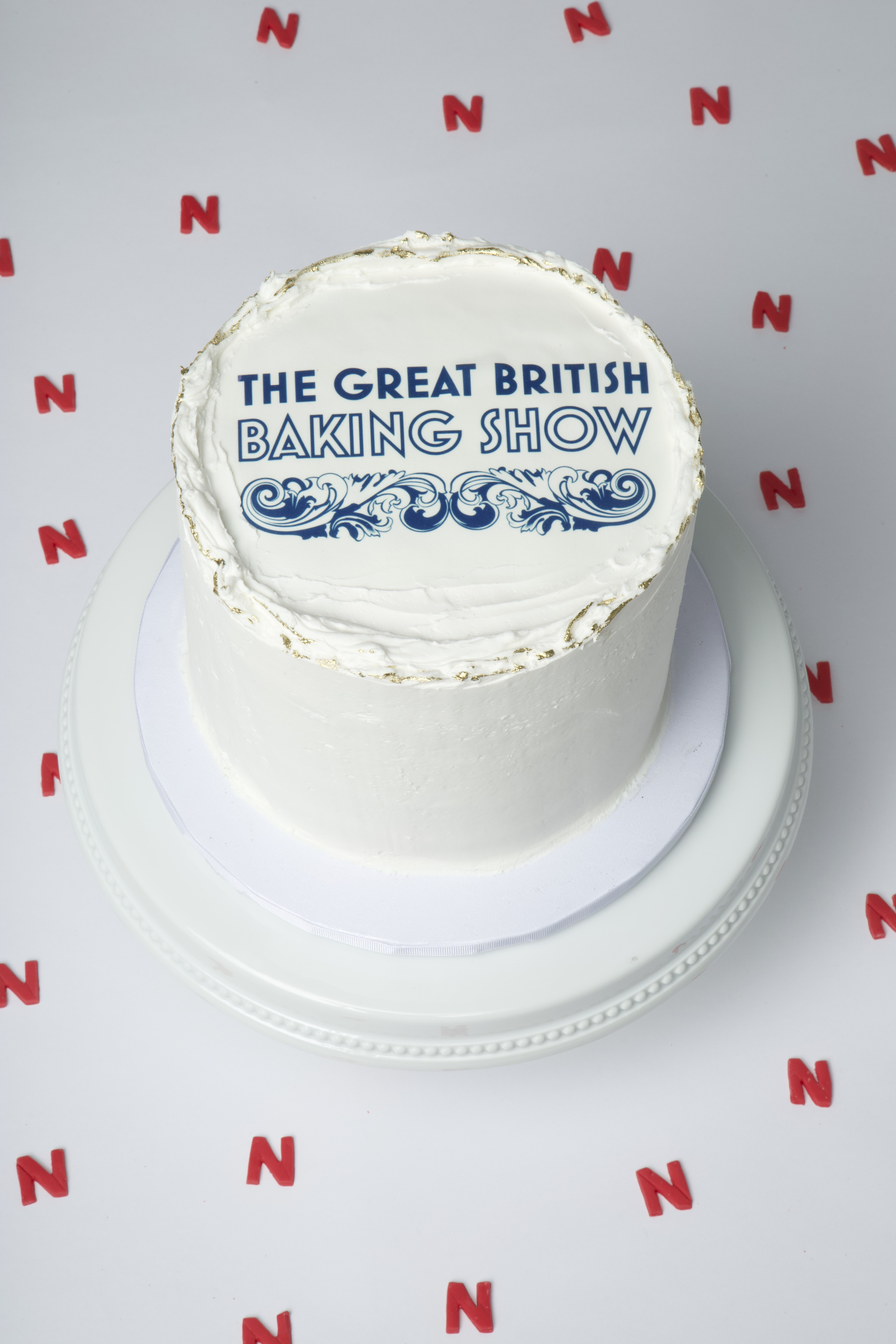 A cake decorated with the great british baking show logo