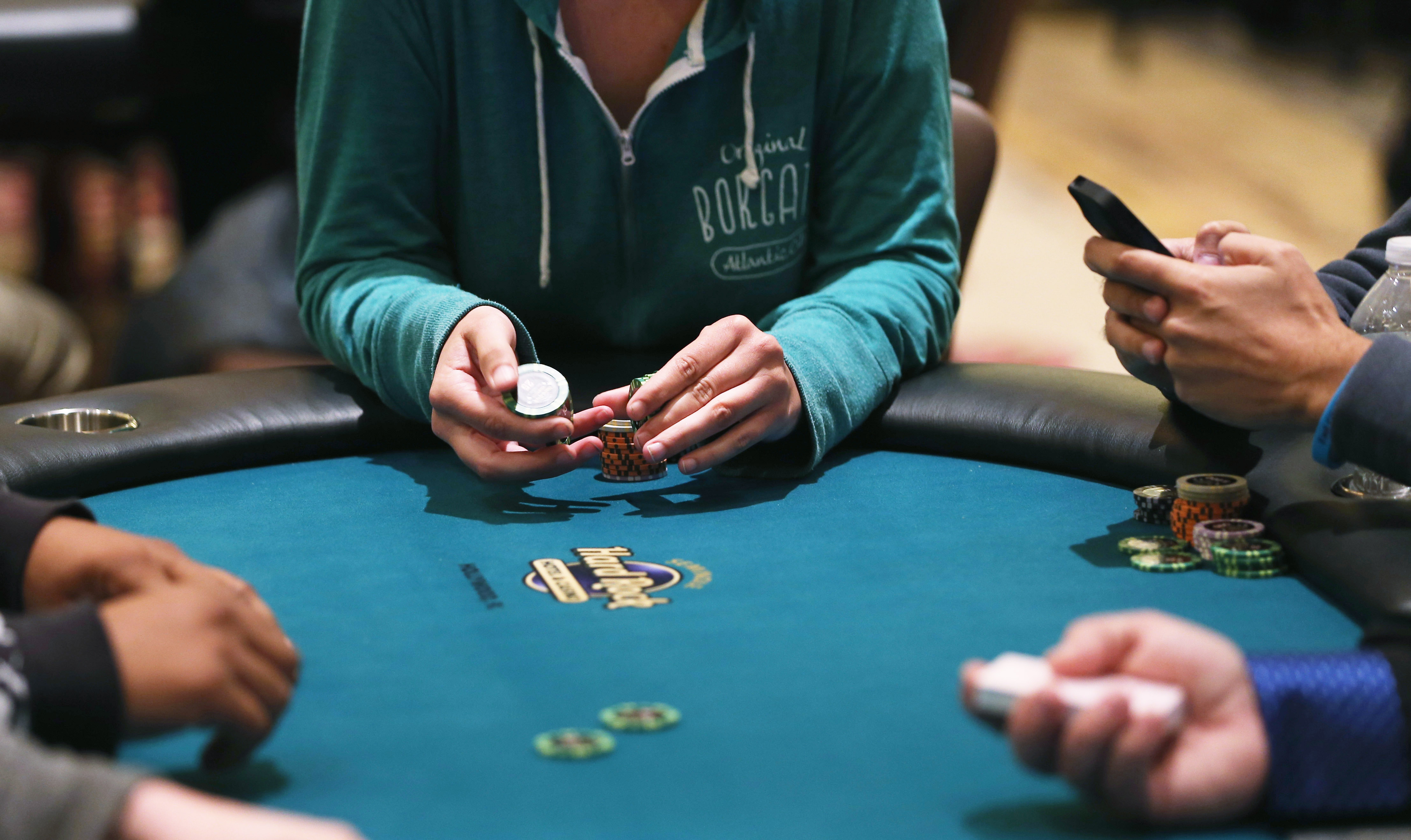 A poker player holds a chip