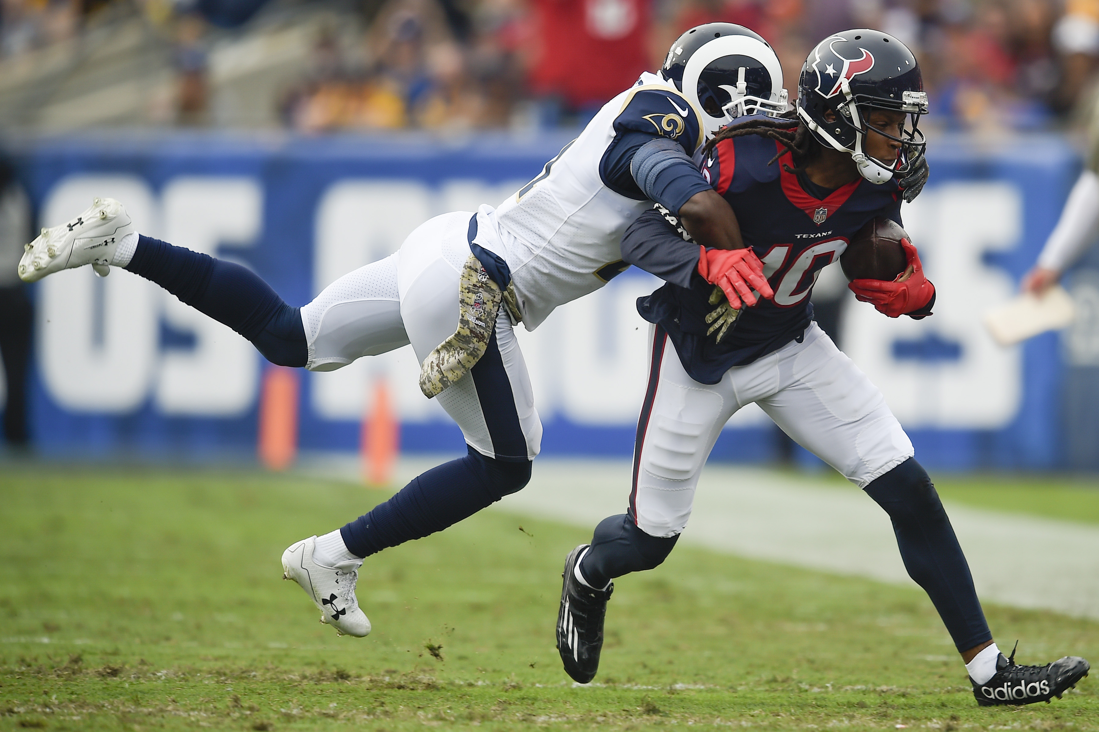 Los Angeles Rams CB Kayvon Webster tackles Houston Texans WR DeAndre Hopkins in Week 10, November 12, 2017.