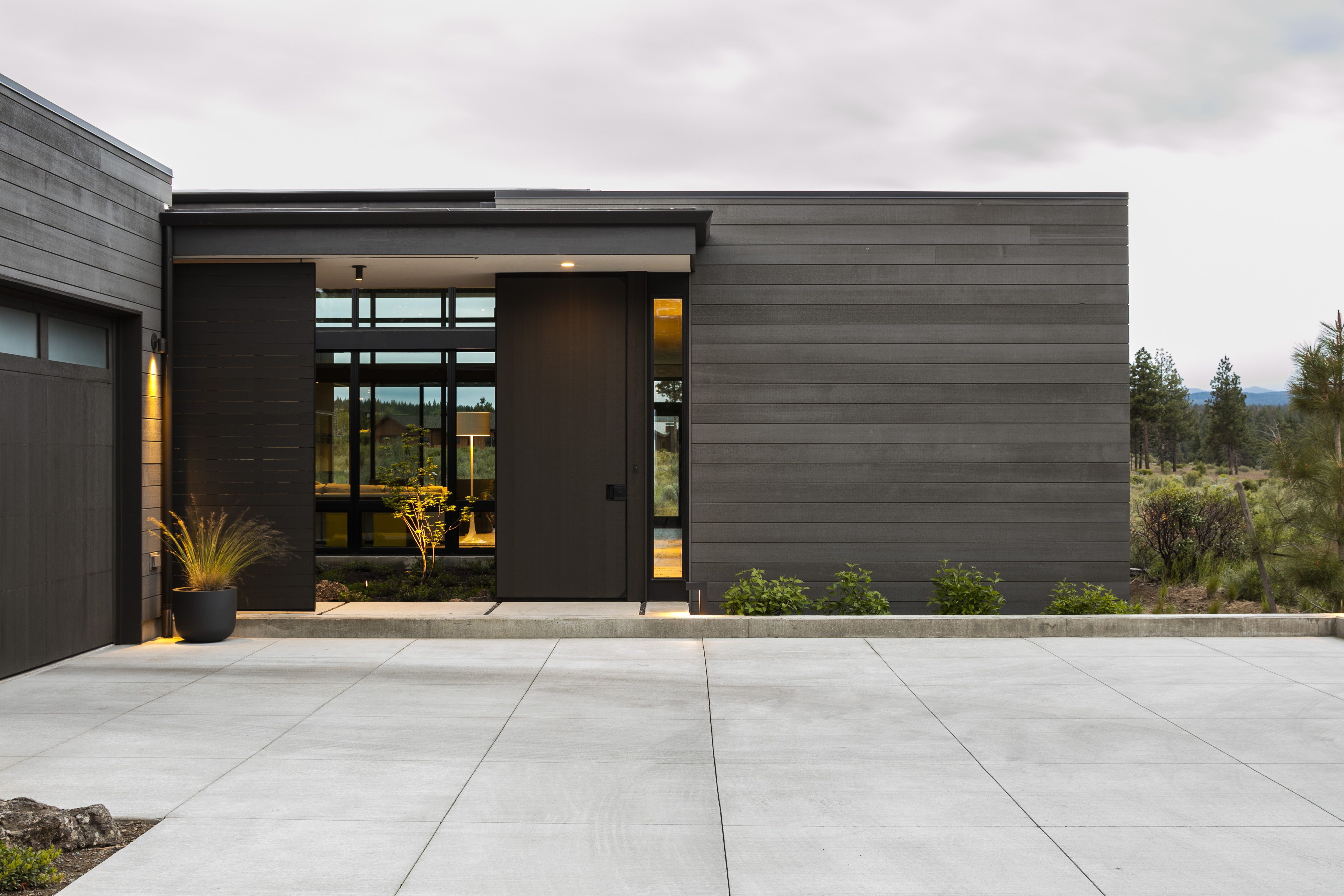 Gray exterior of modern house and driveway