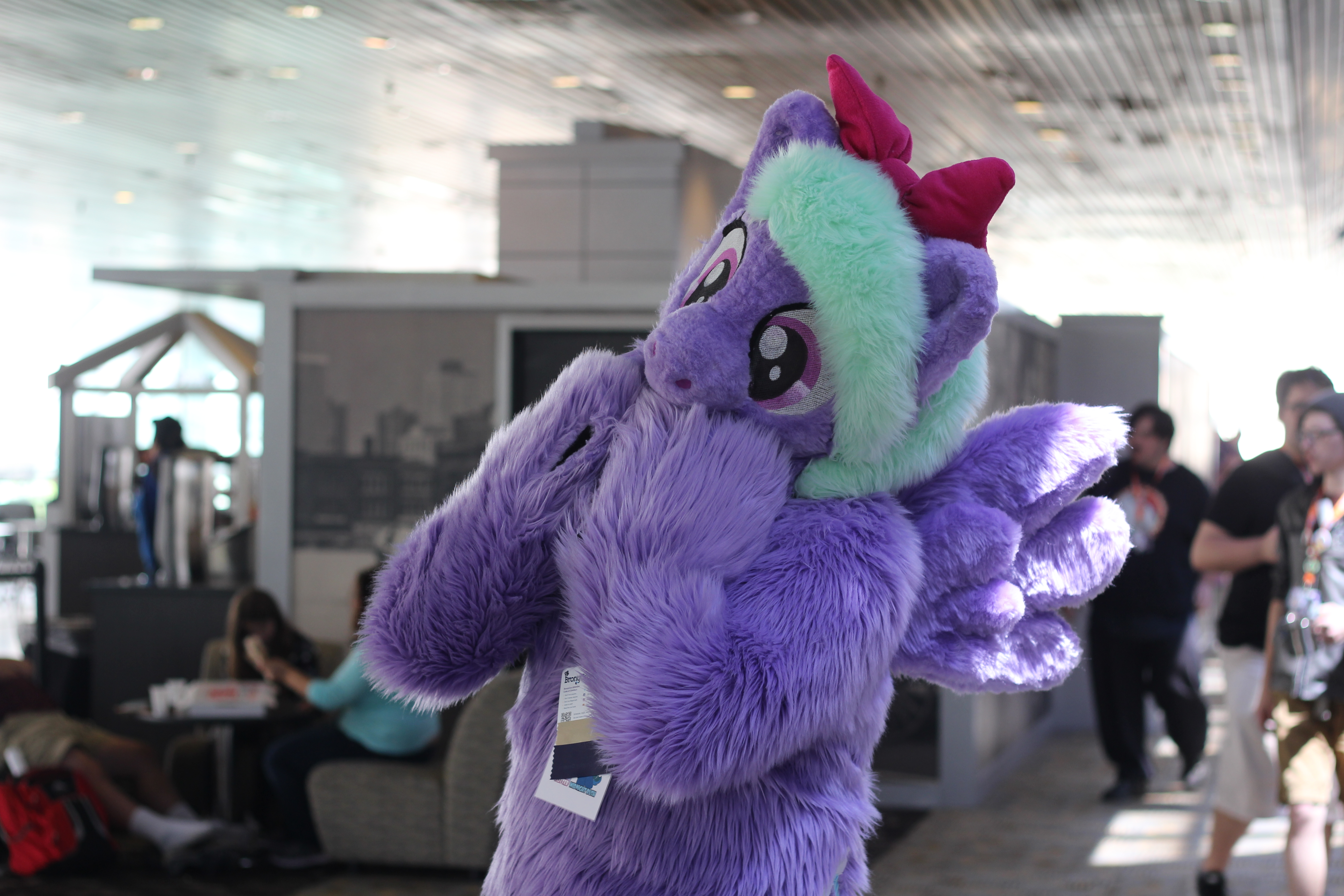 A cosplayer dressed as the Friendship is Magic character Flitter, a pegasus.