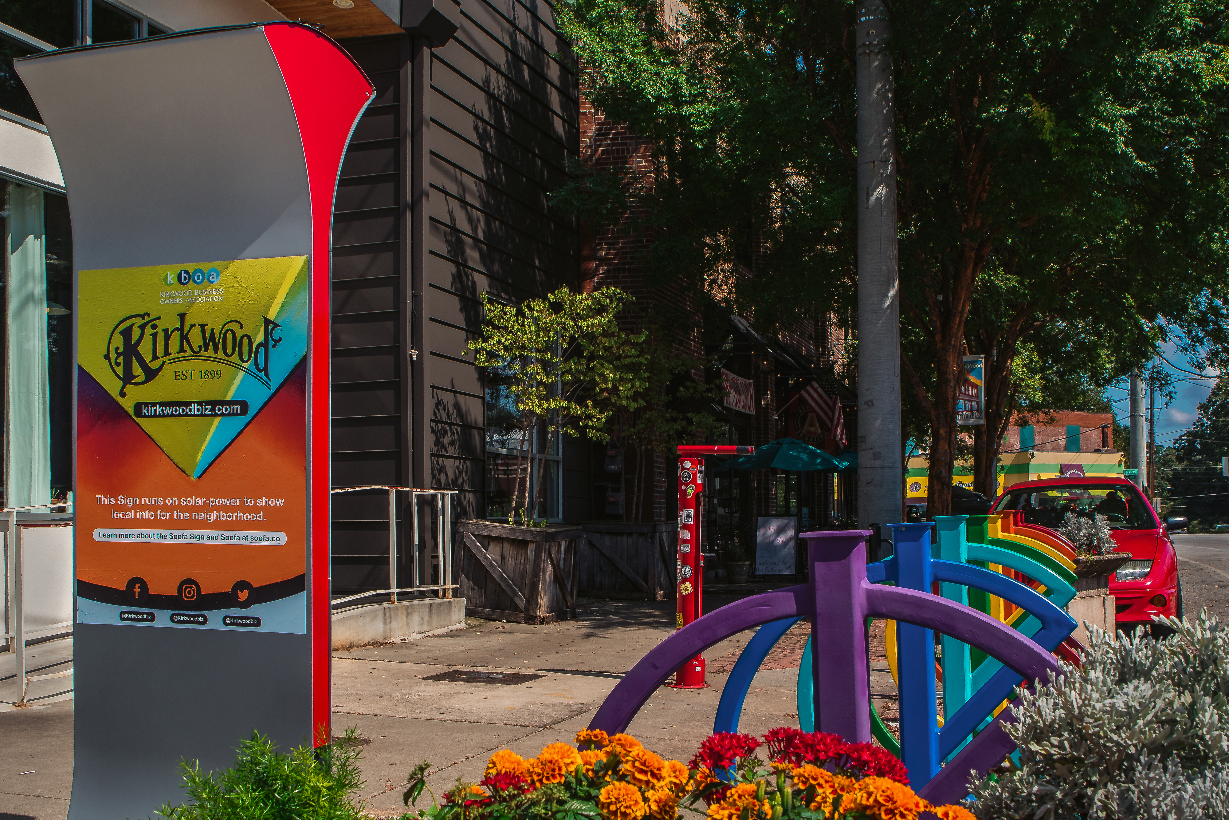 A gray sign with colorful Kirkwood announcement.