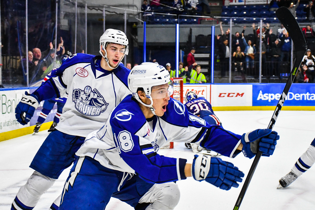Syracuse Crunch Dennis Yan (18) celebrates his overtime goal against the Rochester Americans in American Hockey League (AHL) action at the War Memorial Arena in Syracuse, New York on Wednesday, November 22, 2017. Syracuse won 6-5 in Overtime.