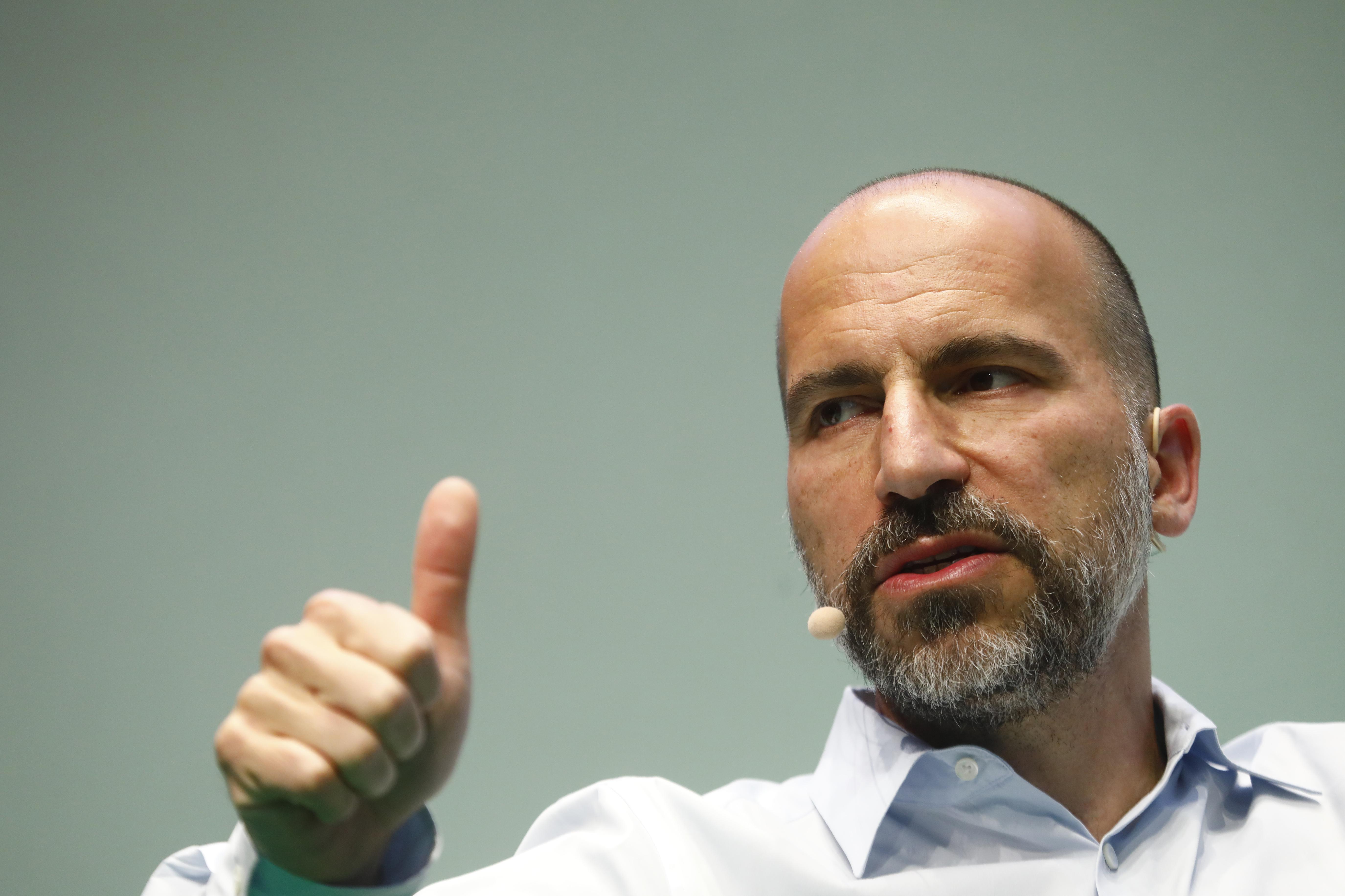 Uber CEO Dara Khosrowshahi gives a thumbs-up gesture