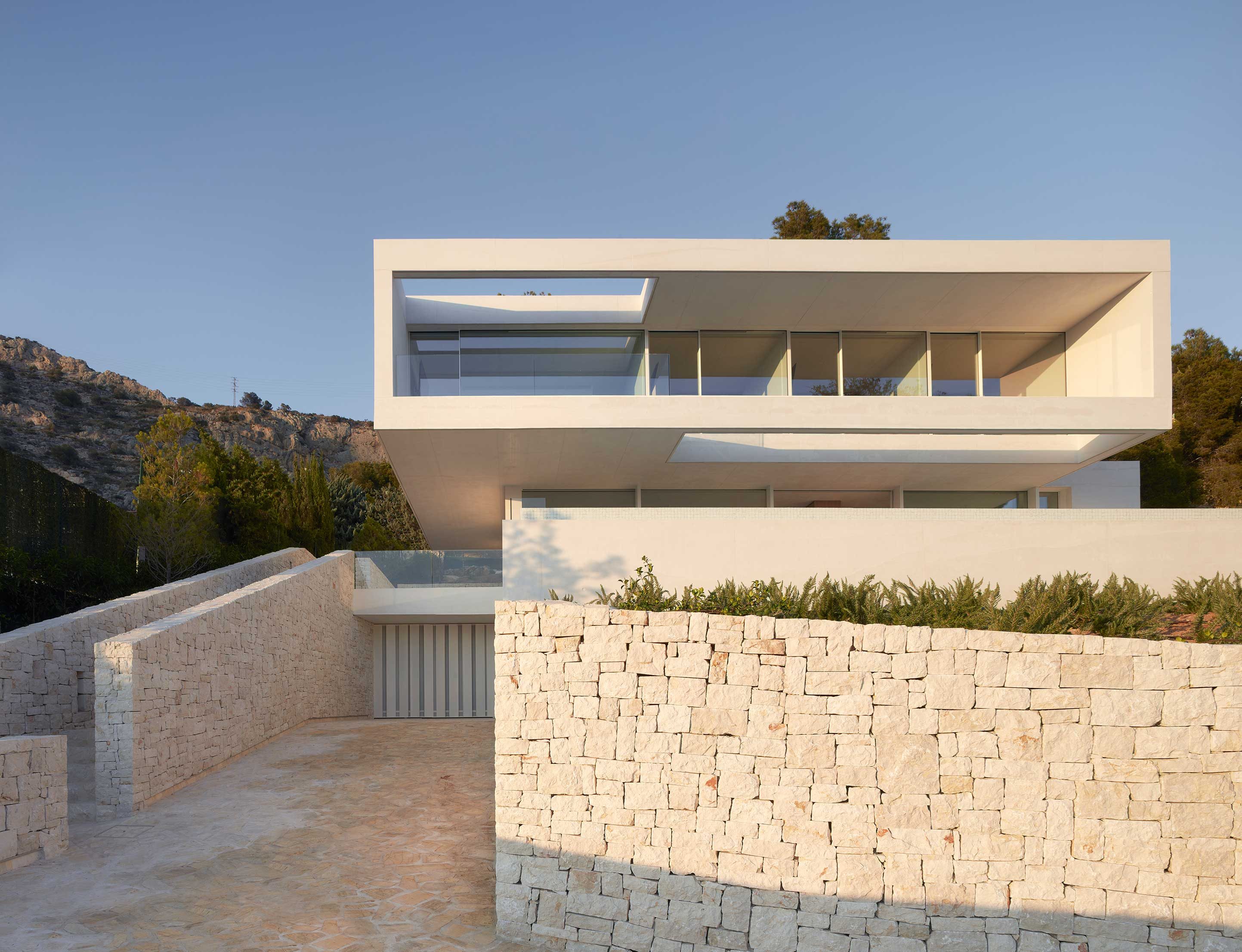 All-white concrete house is beautifully high-maintenance