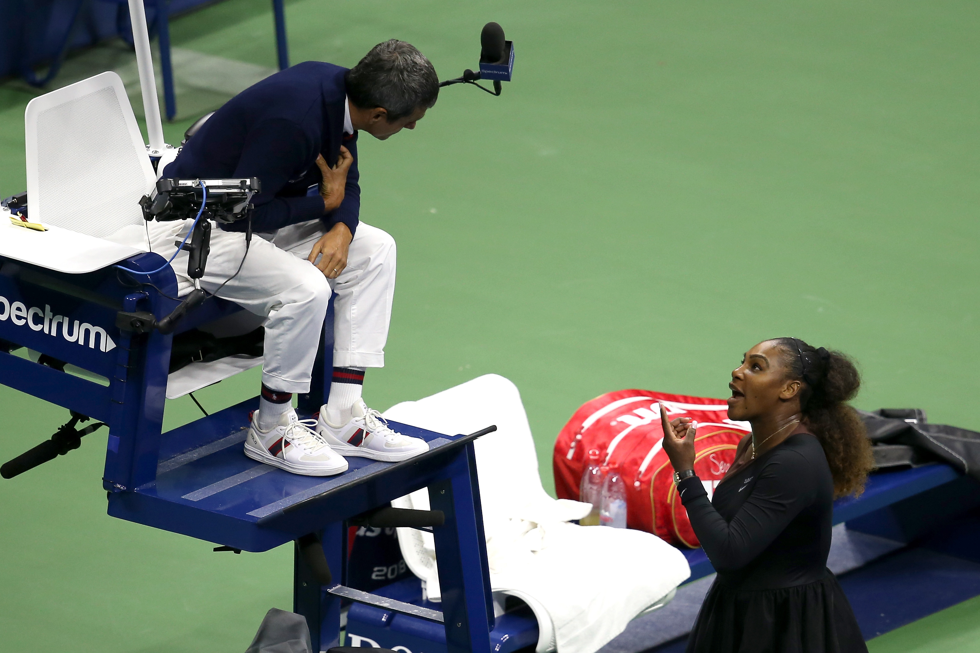 Serena Williams argues with umpire Carlos Ramos during the Women's singles finals match against Naomi Osaka at the US Open