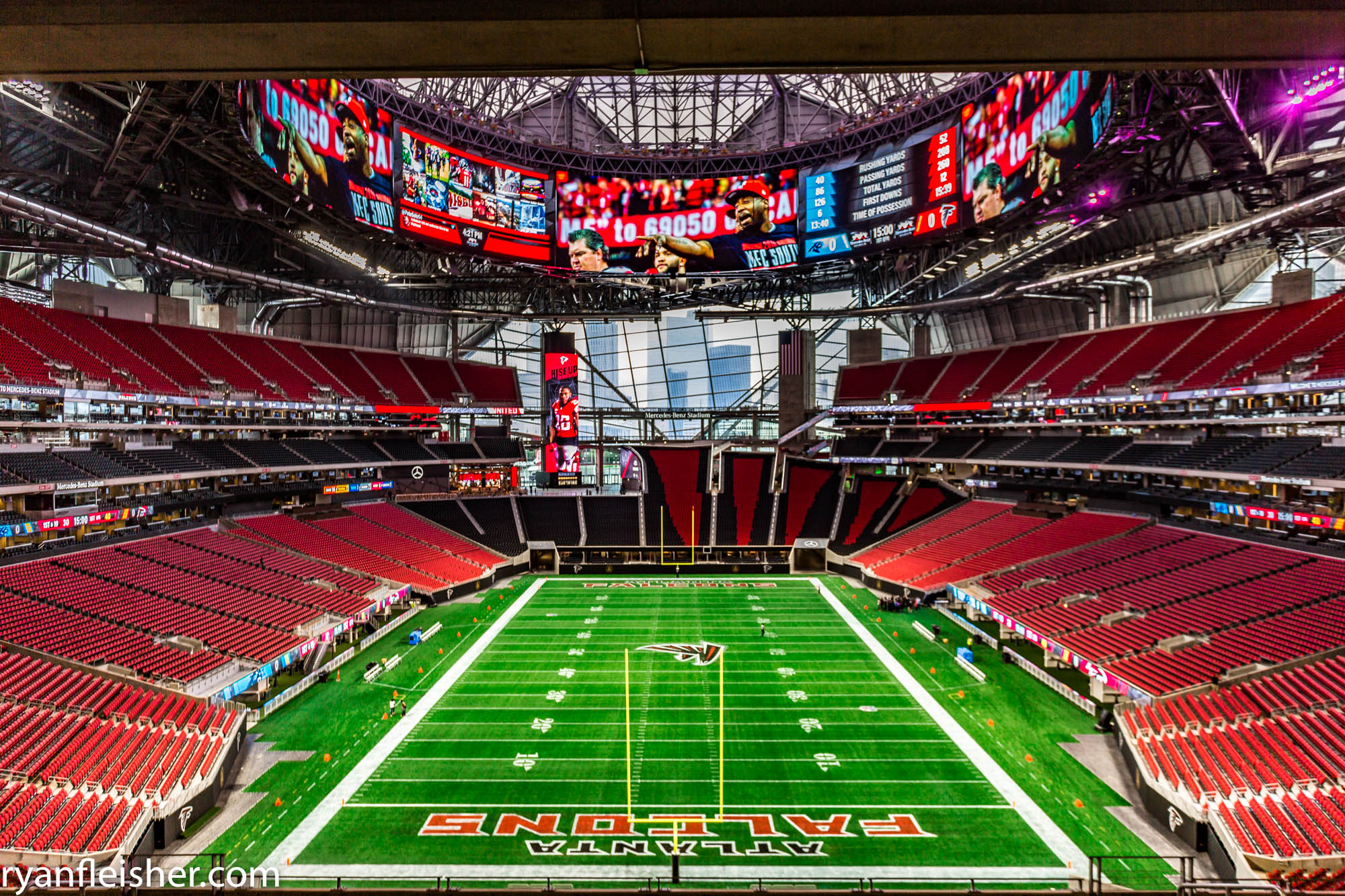 The playing field and stands inside Mercedes-Benz Stadium.