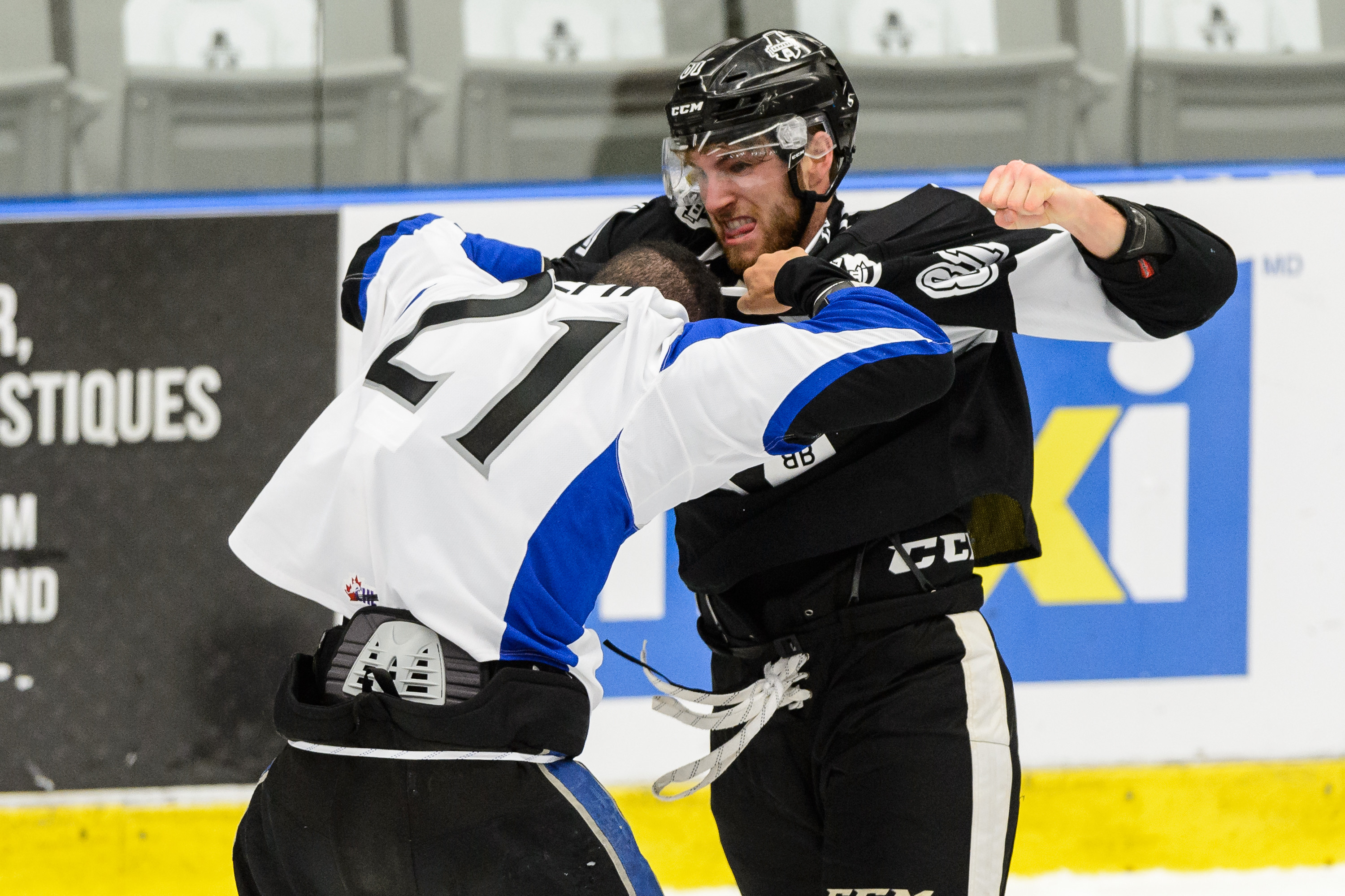 BOISBRIAND, QC - OCTOBER 12: Jeremy Roy #81 of the Blainville-Boisbriand Armada fights with Mathieu Joseph #21 of the Saint John Sea Dogs during the QMJHL game at the Centre d'Excellence Sports Rousseau on October 12, 2016 in Boisbriand, Quebec, Canada.
