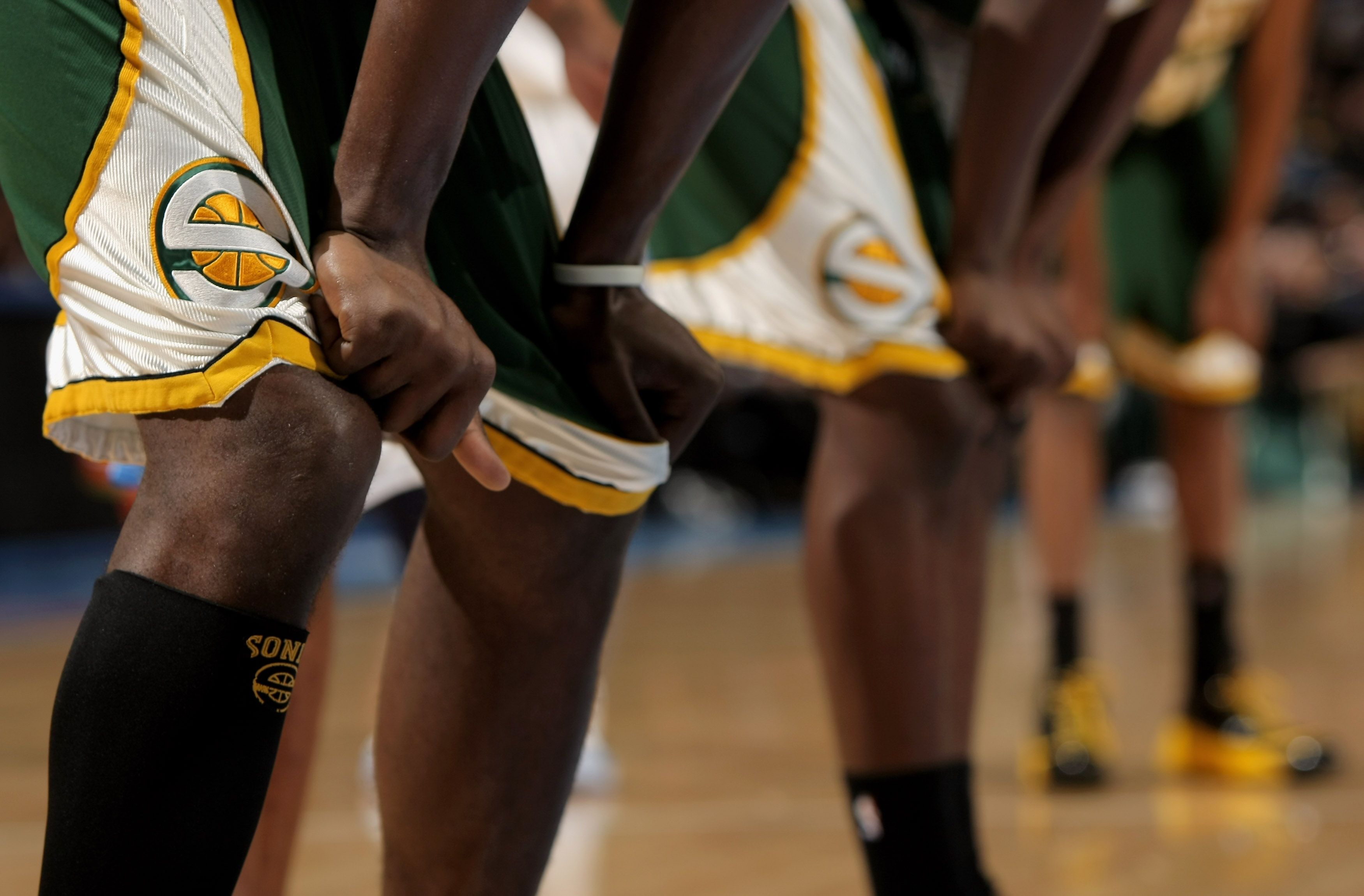 Members of the Seattle SuperSonics grabs their shorts as they are trounced by the Denver Nuggets at the Pepsi Center March 16, 2008 in Denver, Colorado.
